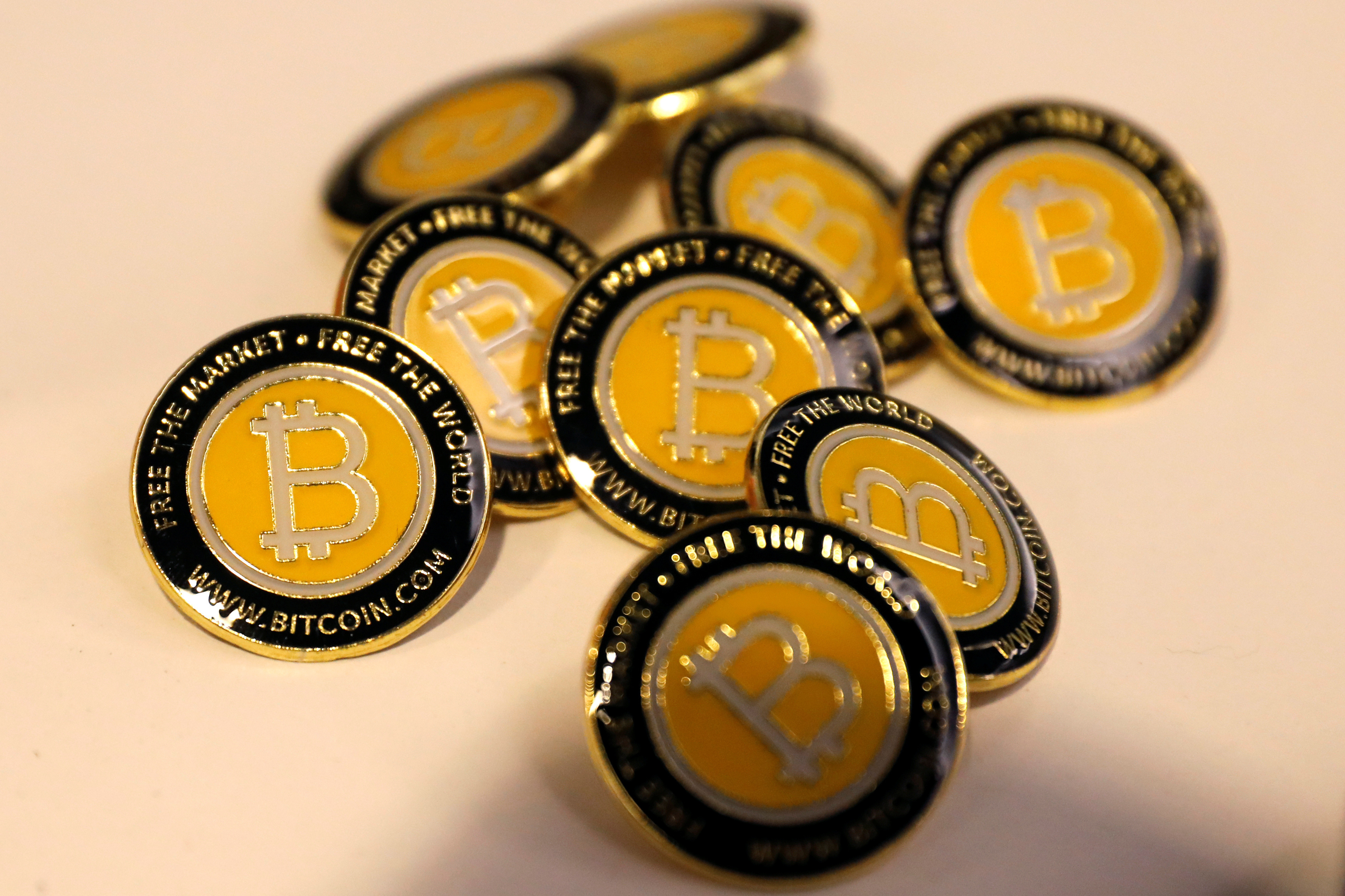 image of Bitcoin buttons (Bitcoin is a cryptocurrency)