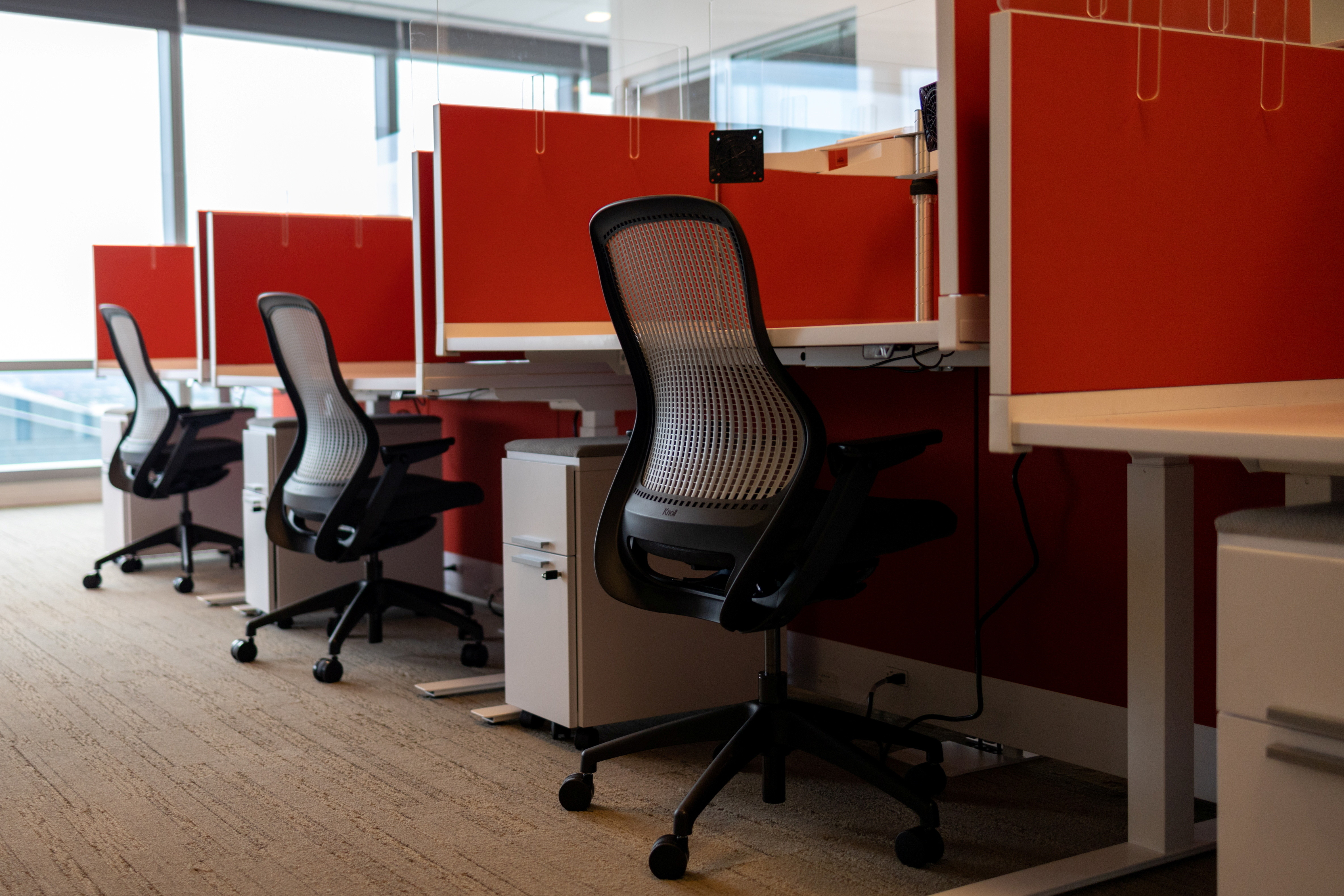 Empty cubicles are seen as the first phase of FMC Corporation employees return to work in the office