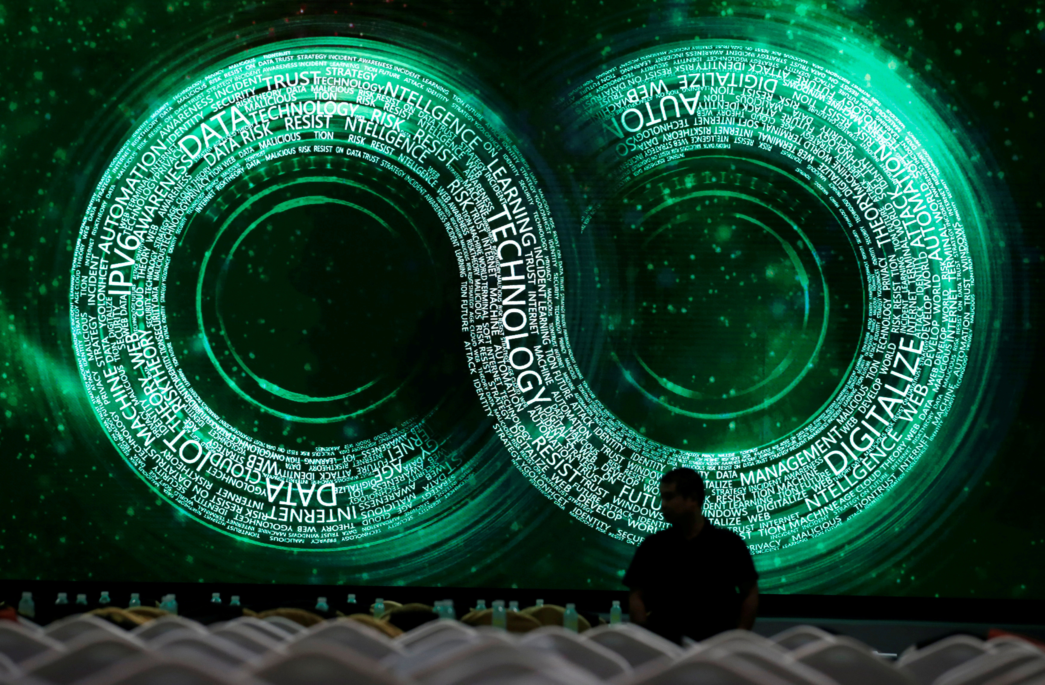 A man stands at a main hall for Internet Security Conference 2018 in Beijing, China September 4, 2018. REUTERS/Jason Lee      TPX IMAGES OF THE DAY - RC1D39B89D00