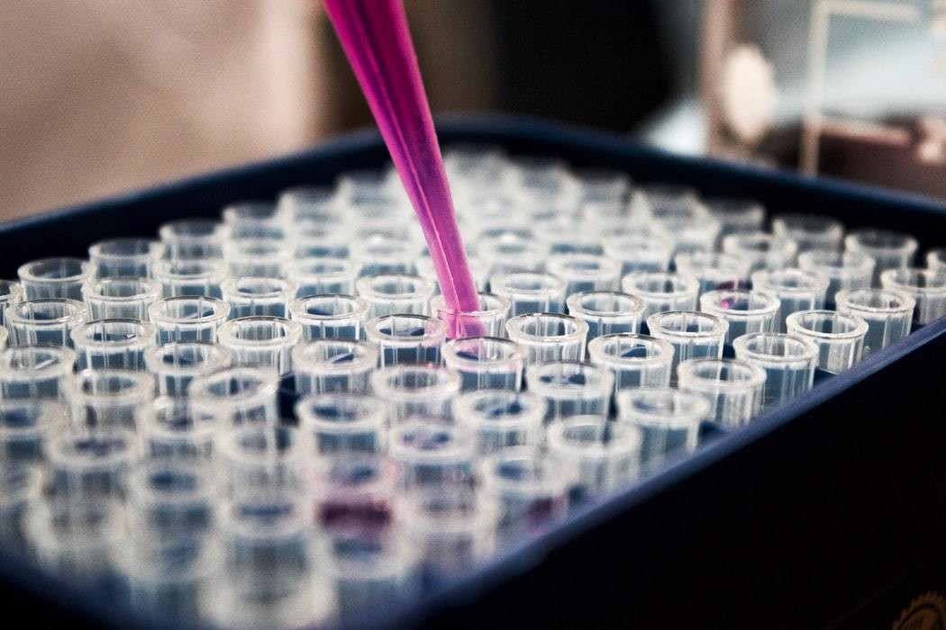 Test tubes being used in a scientific lab