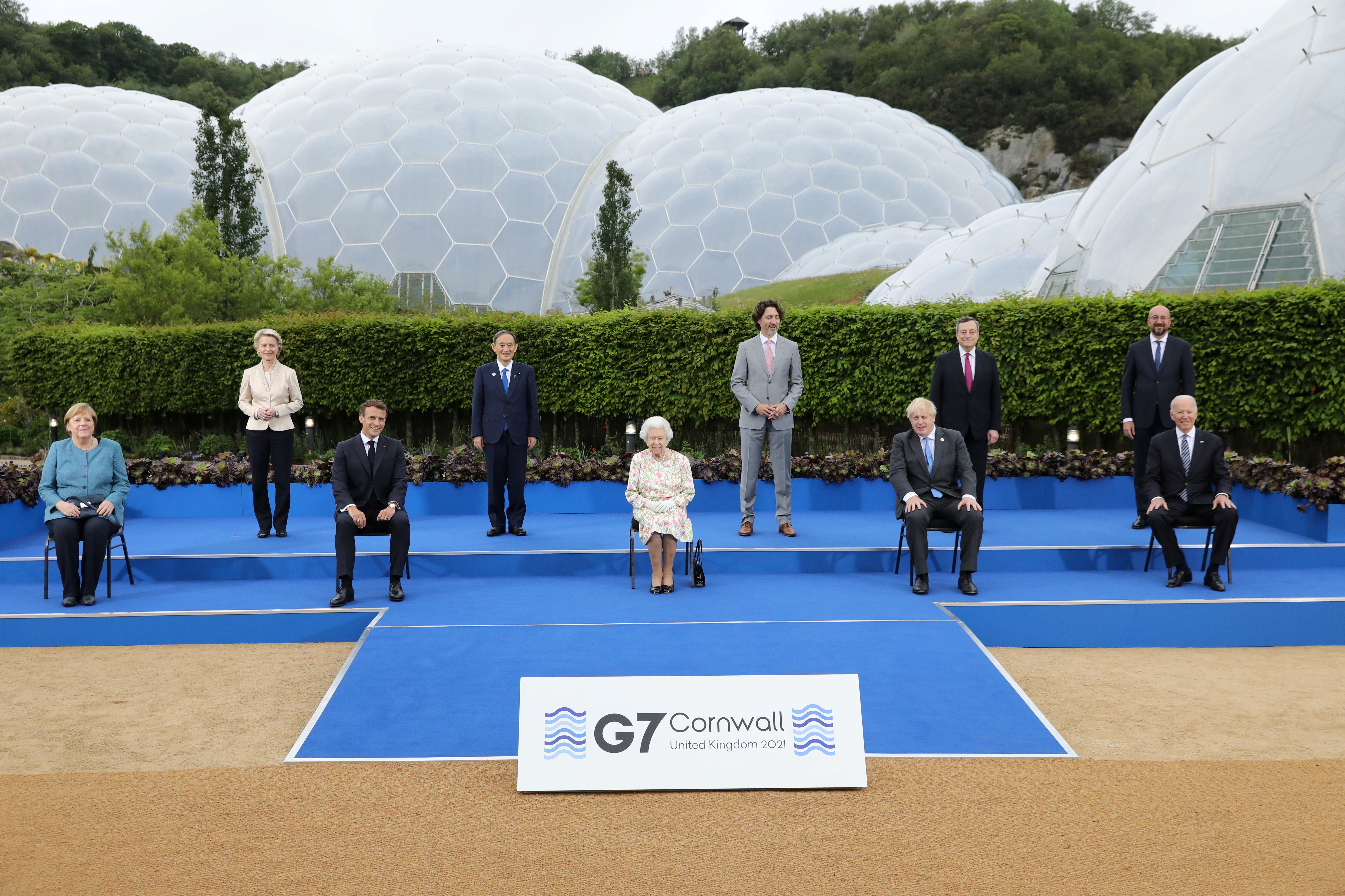 A picture of the G7 leaders with Queen Elizabeth II, including European Commission President Ursula von der Leyen, German Chancellor Angela Merkel, Japan's Prime Minister Yoshihide Suga, France's President Emmanuel Macron along with Britain's Queen Elizabeth, Canada's Prime Minister Justin Trudeau, Britain's Prime Minister Boris Johnson, Italy's Prime Minister Mario Draghi, U.S. President Joe Biden and European Council President Charles Michel