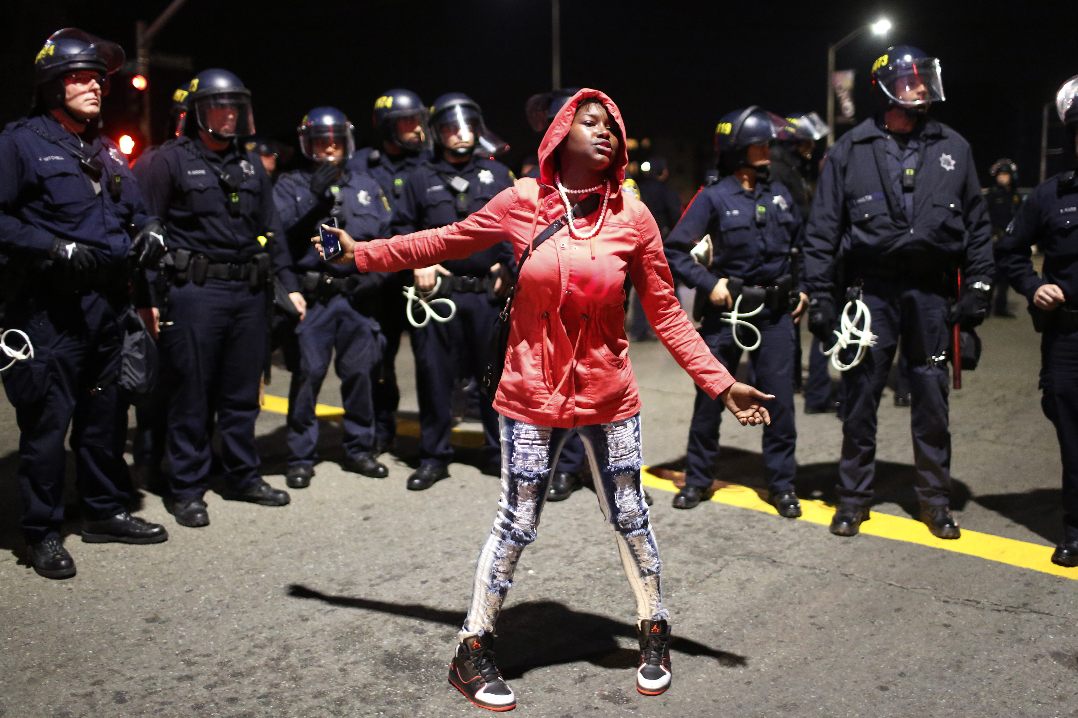 A woman takes part in a demonstration against police violence in Oakland, California in 2014.