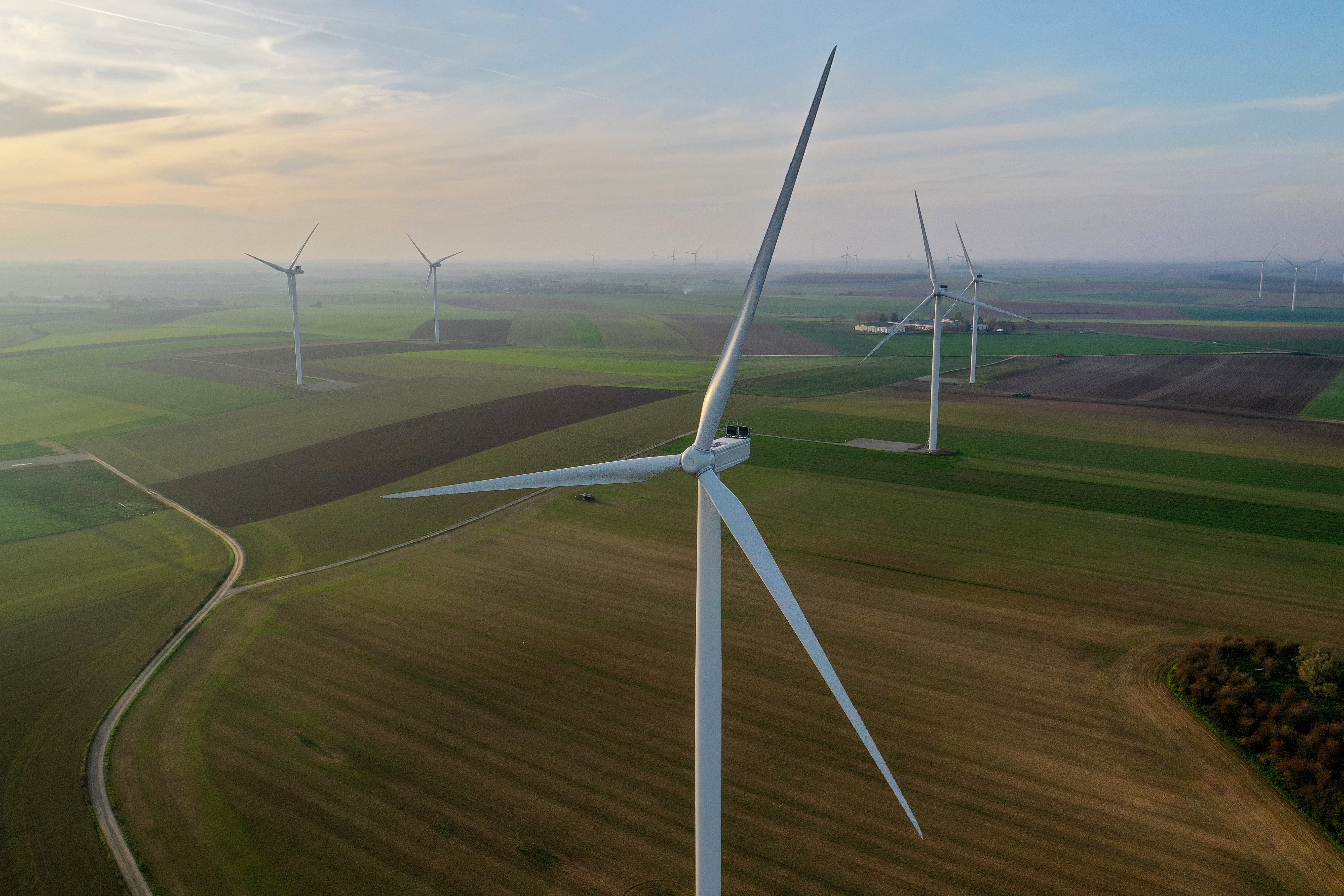 An aerial view shows power-generating windmill turbines in a wind farm in Graincourt-les-havrincourt, France, November 7, 2020. Picture taken, November 7, 2020 with a drone.  REUTERS/Pascal Rossignol - RC25ZJ9WFVGV