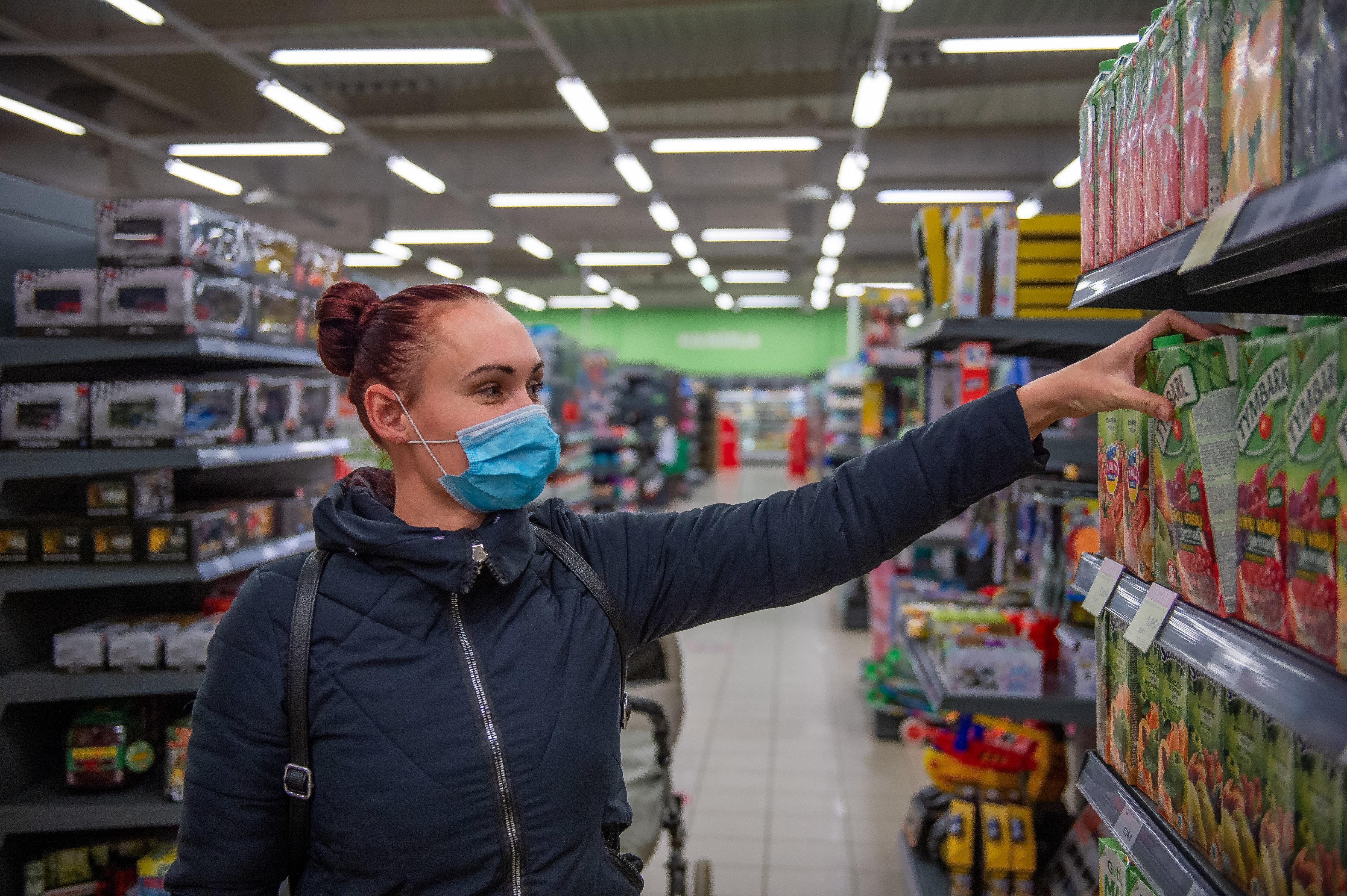 a woman does grocery shopping during the pandemic
