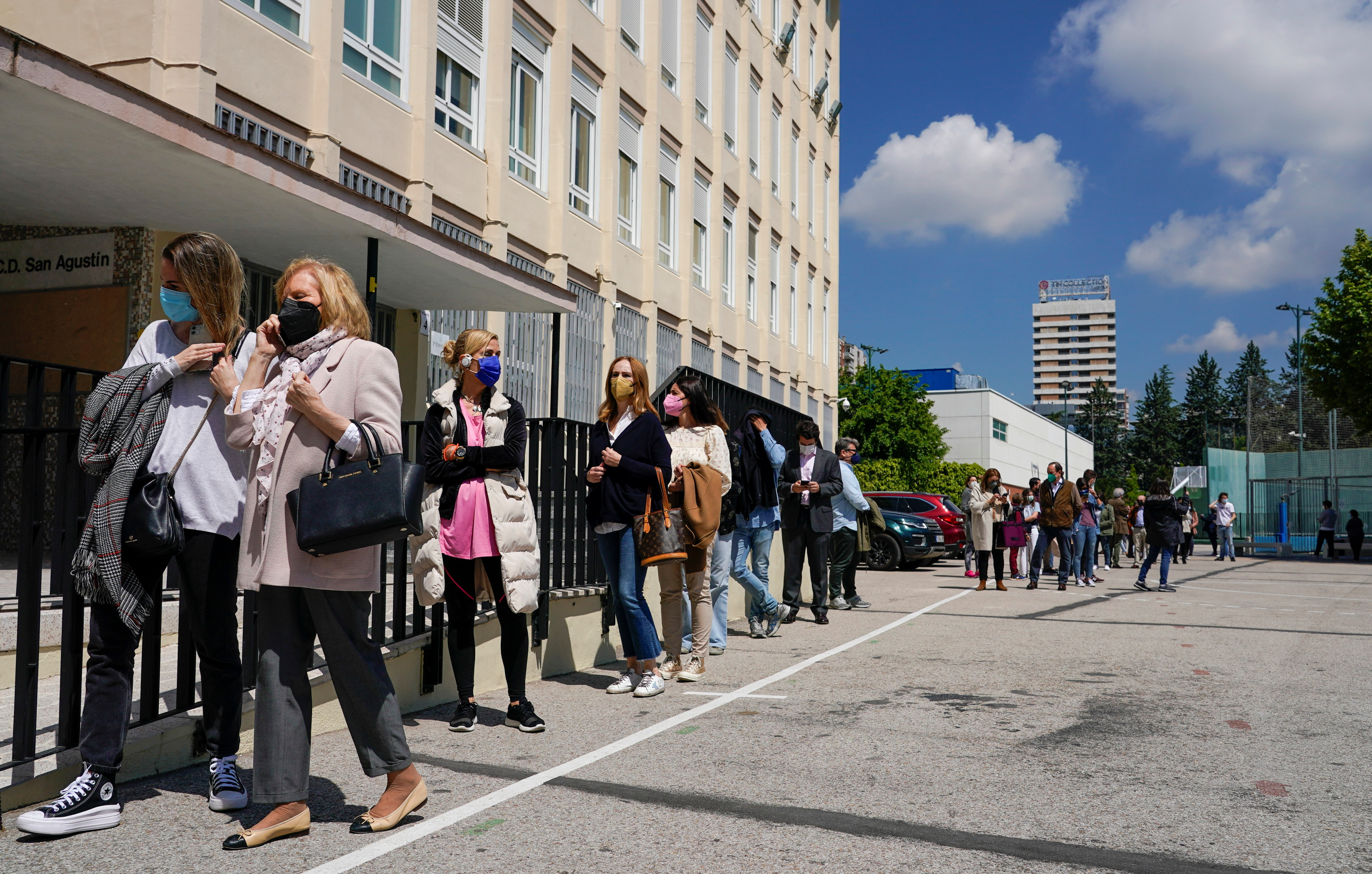 Voters, wearing protective face masks and keeping social distance, queue outside a polling station during Madrid's Regional elections, in Madrid, Spain, May 4, 2021. REUTERS/Juan Medina - RC2Y8N9W3GB5