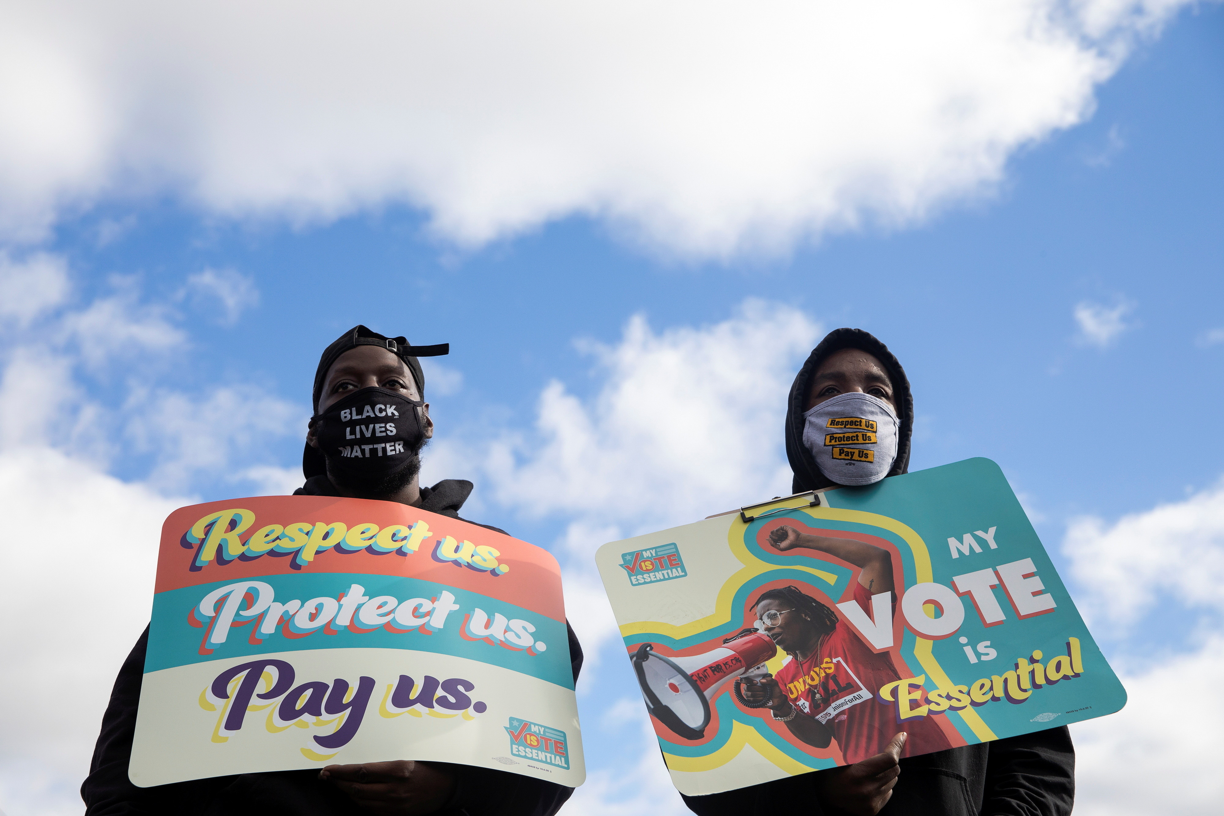 """People join fast-food and nursing home workers during a """"My Vote is Essential"""" rally before casting their early ballots, amid the coronavirus disease (COVID-19) concerns at Wayne County Community College in Detroit, Michigan, U.S., October 24, 2020.  REUTERS/Emily Elconin - RC26PJ9M0LAO"""