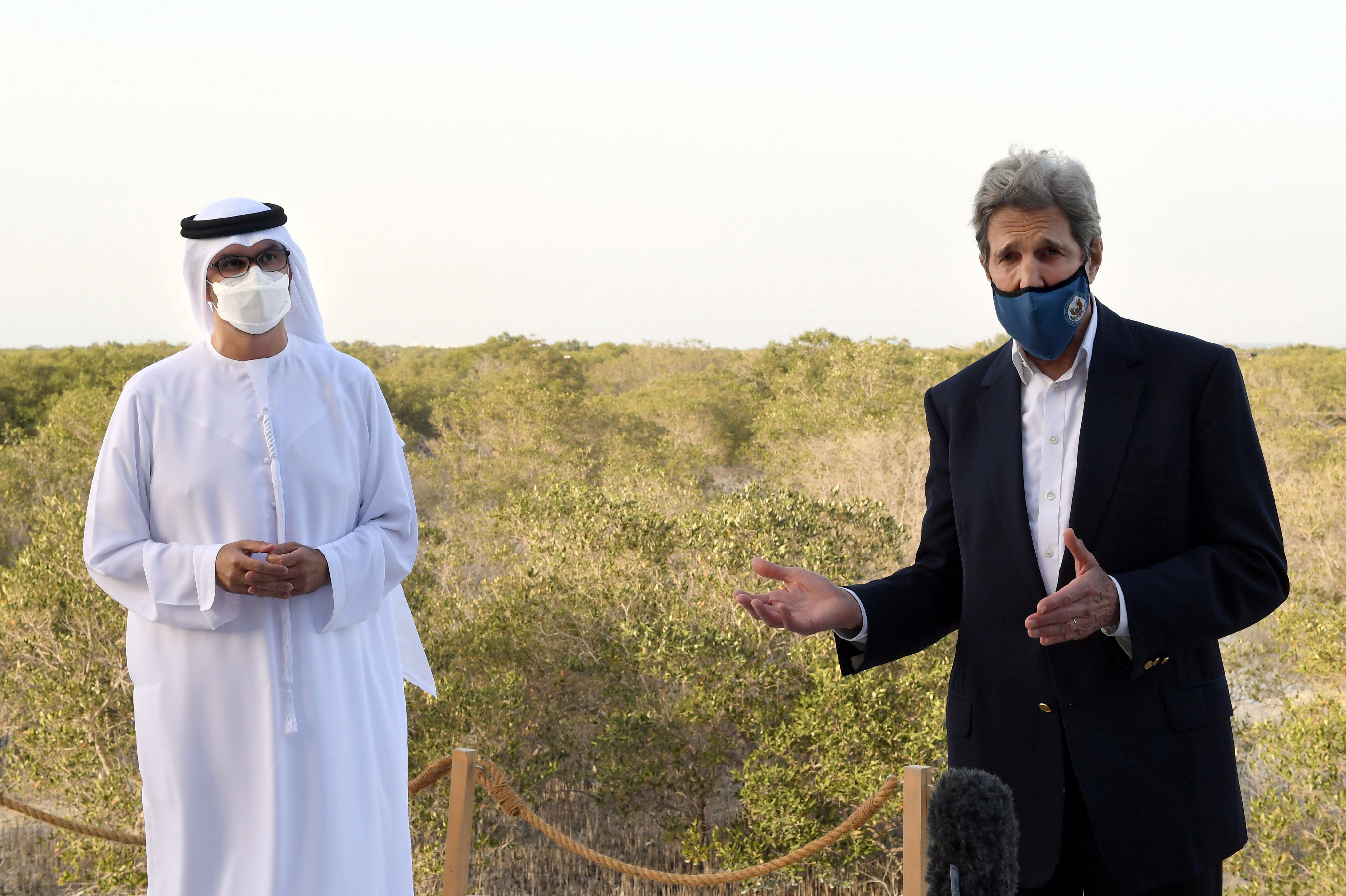 U.S. Special Presidential Envoy for Climate John Kerry speaks alongside UAE Special Envoy for Climate Change and Abu Dhabi National Oil Company CEO, Sultan Ahmed Al Jaber, during a visit to Jubail Mangrove Park, in Abu Dhabi, United Arab Emirates April 3, 2021.