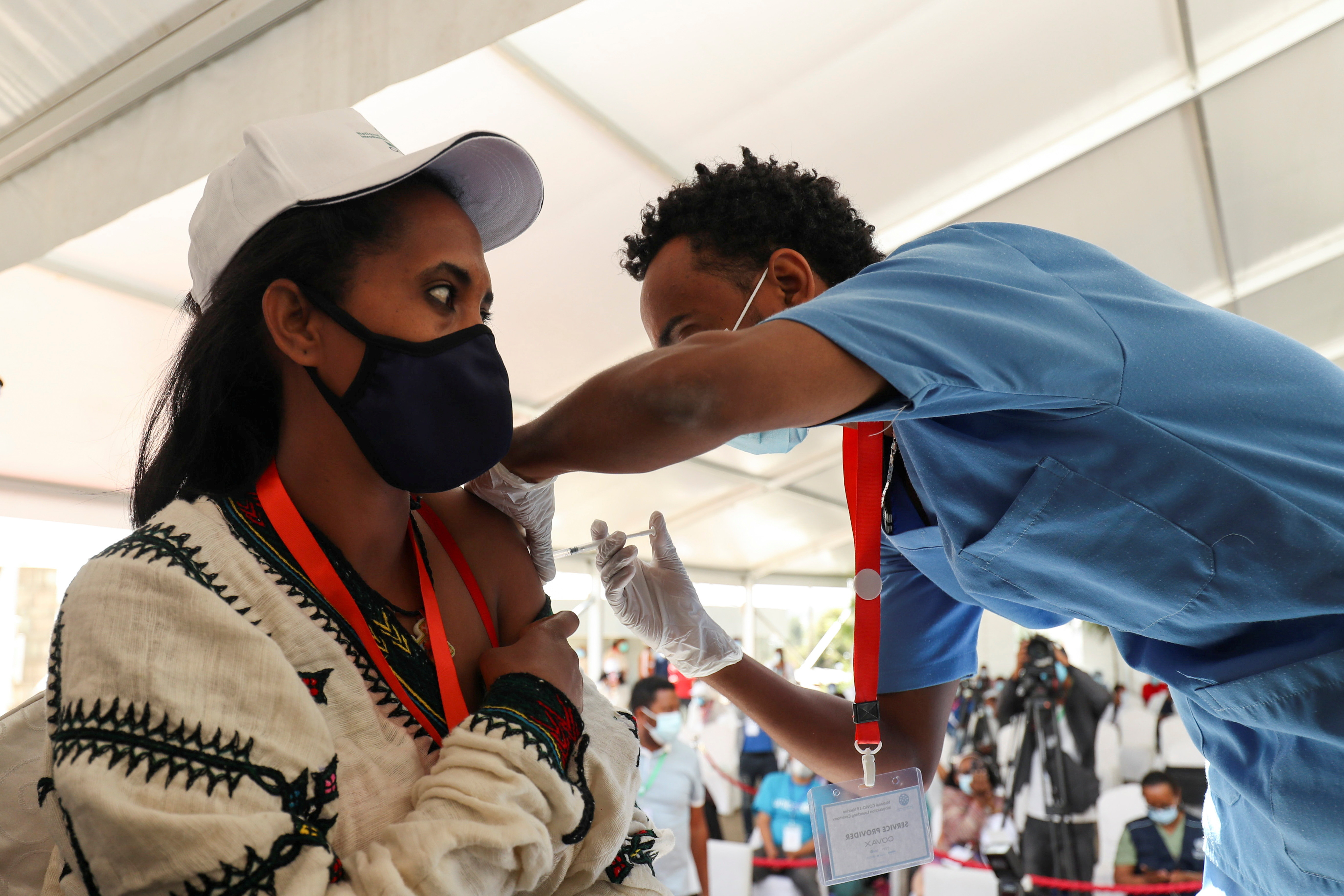A woman receives the AstraZeneca/Oxford vaccine under the COVAX scheme against the coronavirus disease (COVID-19) at the Eka Kotebe General Hospital in Addis Ababa, Ethiopia March 13, 2021. REUTERS/Tiksa Negeri - RC2AAM9QQ26Y