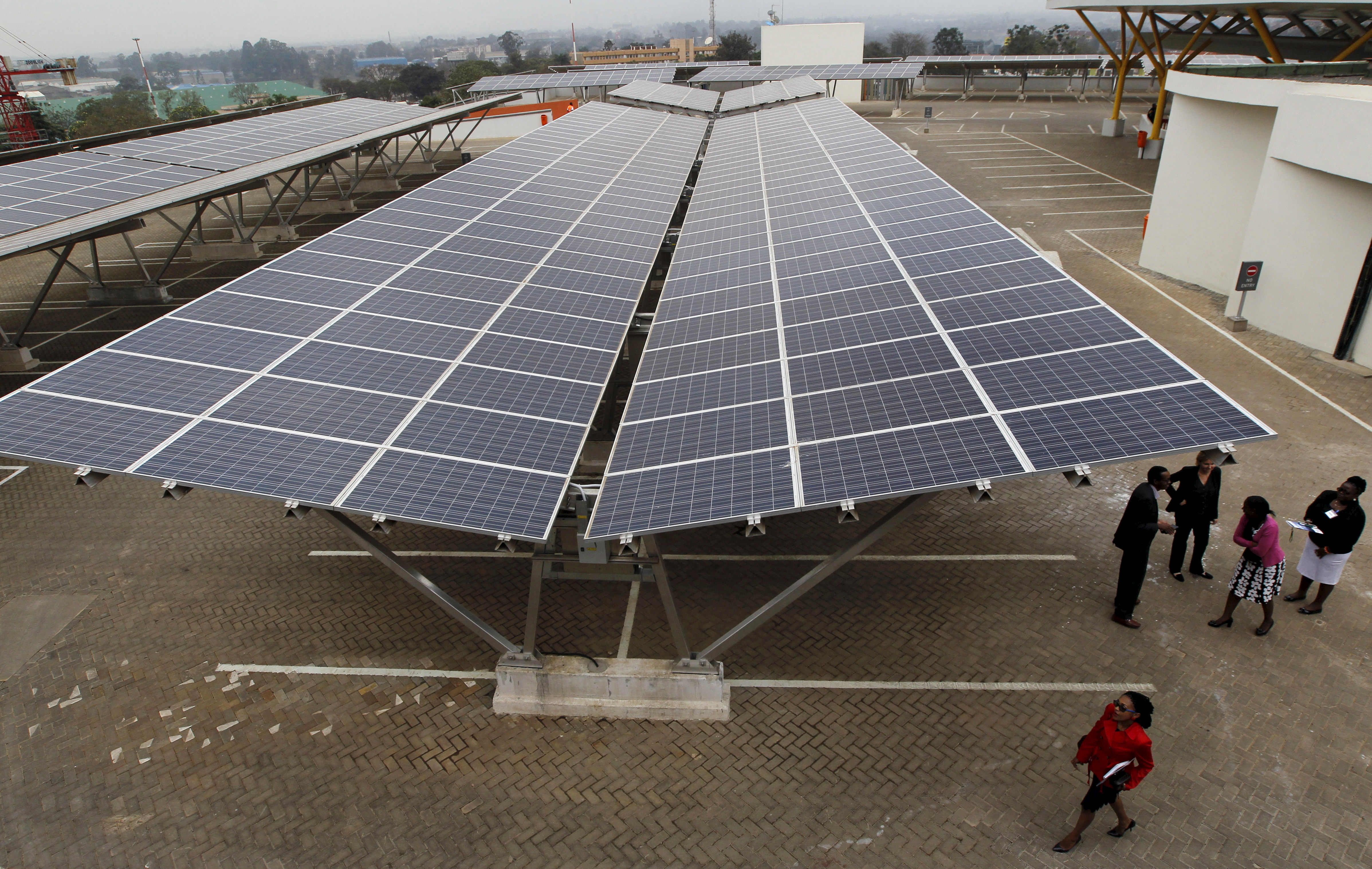 Delegates are pictured during the launch event of a solar carport at the Garden City shopping mall in Kenya's capital Nairobi, September 15, 2015. The Africa's largest solar carport with 3,300 solar panels will generate 1256 MWh annually and cut carbon emission by around 745 tonnes per year, according to Solarcentury and Solar Africa.  REUTERS/Thomas Mukoya - GF10000206535