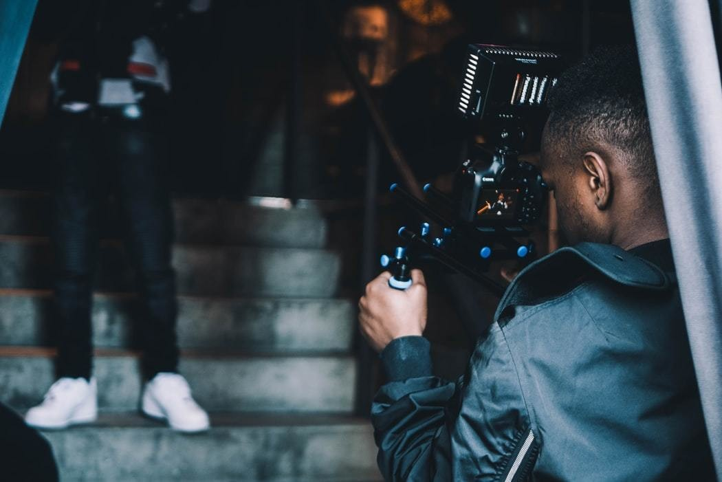image of a camera man filming