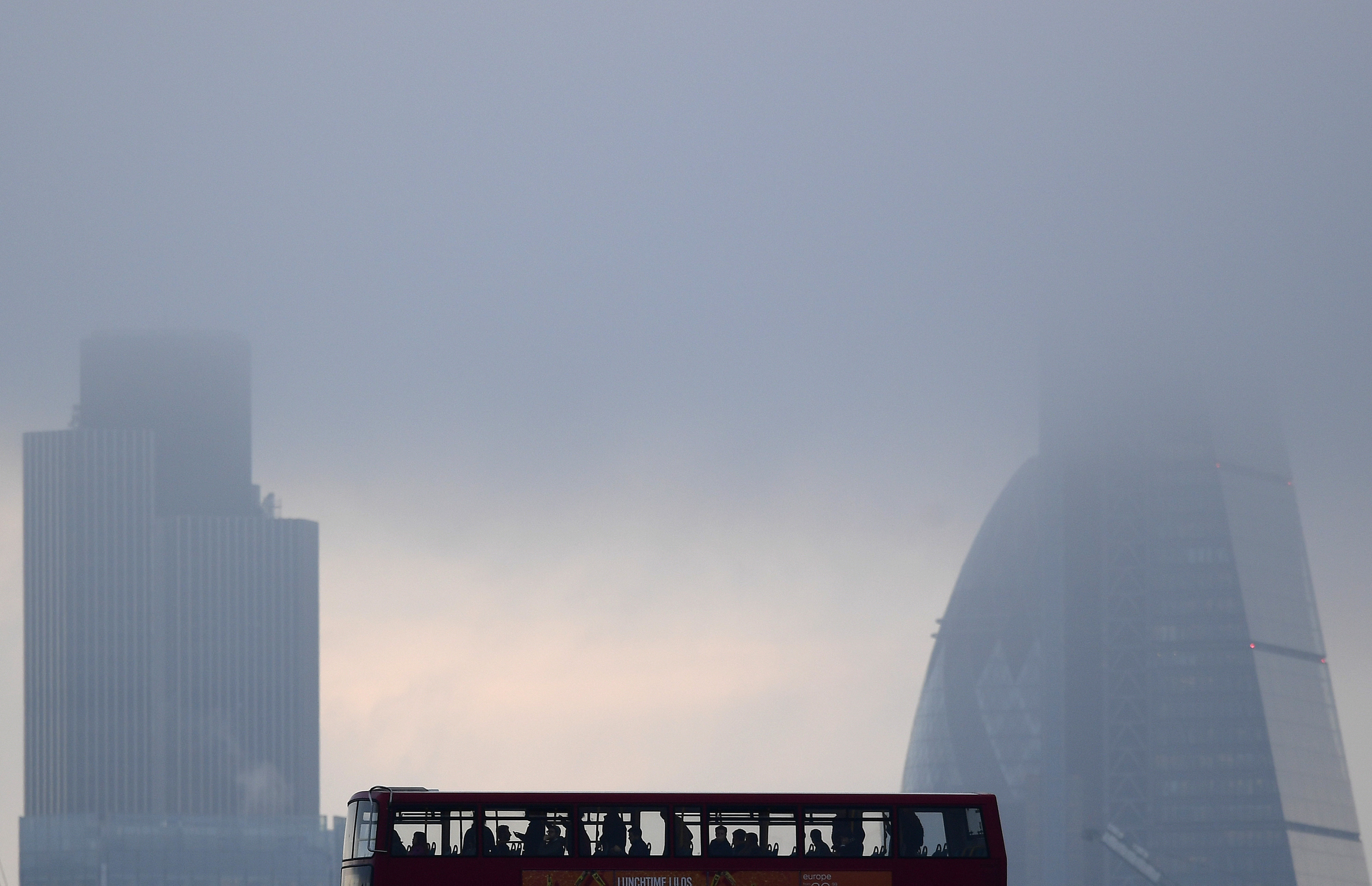 City workers cross the River Thames with the City of London financial district seen behind in London, in Britain October 27, 2016. REUTERS/Toby Melville - LR1ECAR0Q5EH9