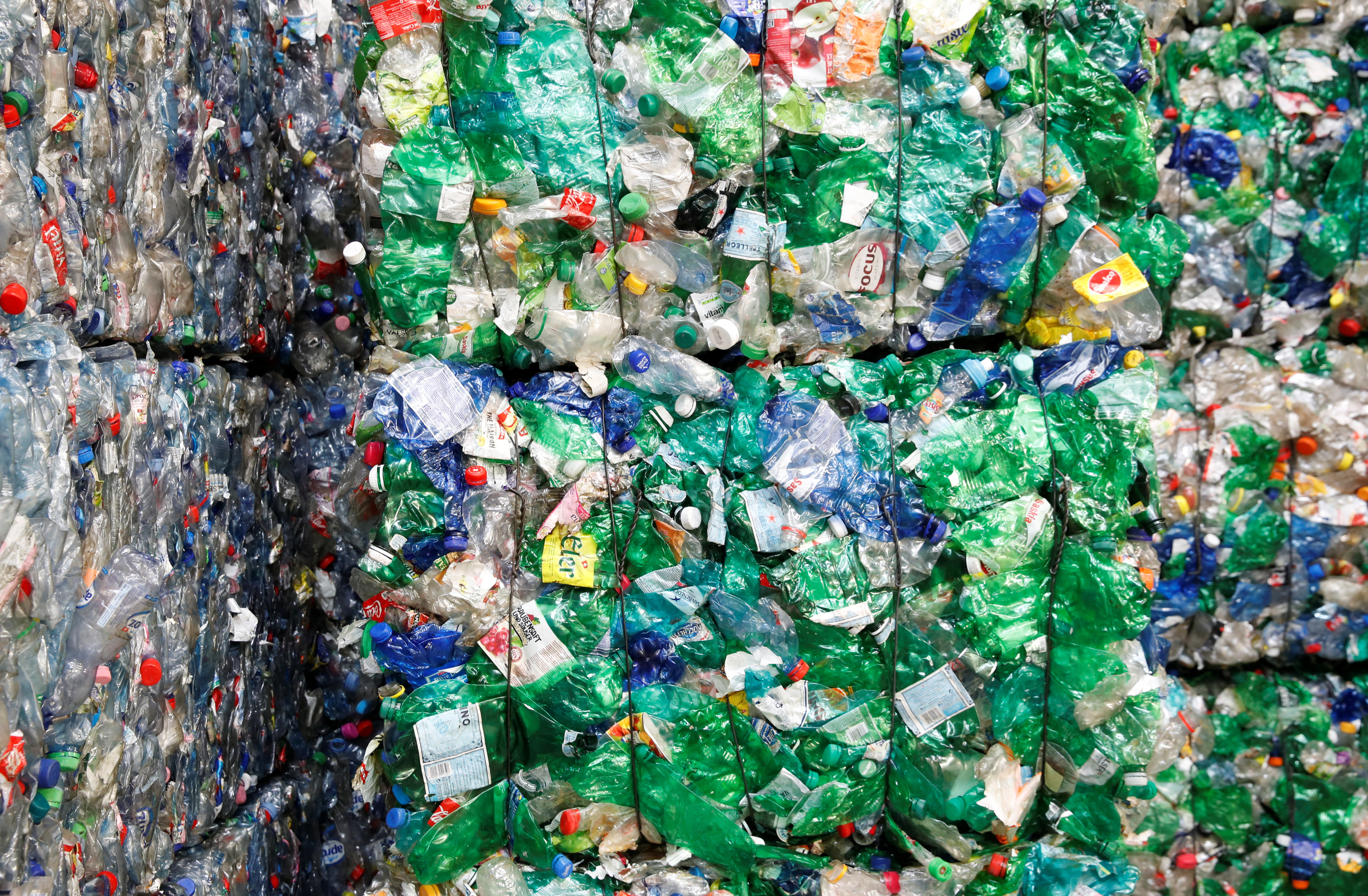 Bundles of pressed PET (polyethylene terephthalate) bottles made out of plastic are seen at the Transcycle Transport & Recycling AG company in Neuenhof, Switzerland November 22, 2018. Picture taken November 22, 2018.   REUTERS/Arnd Wiegmann - RC11F538D6C0