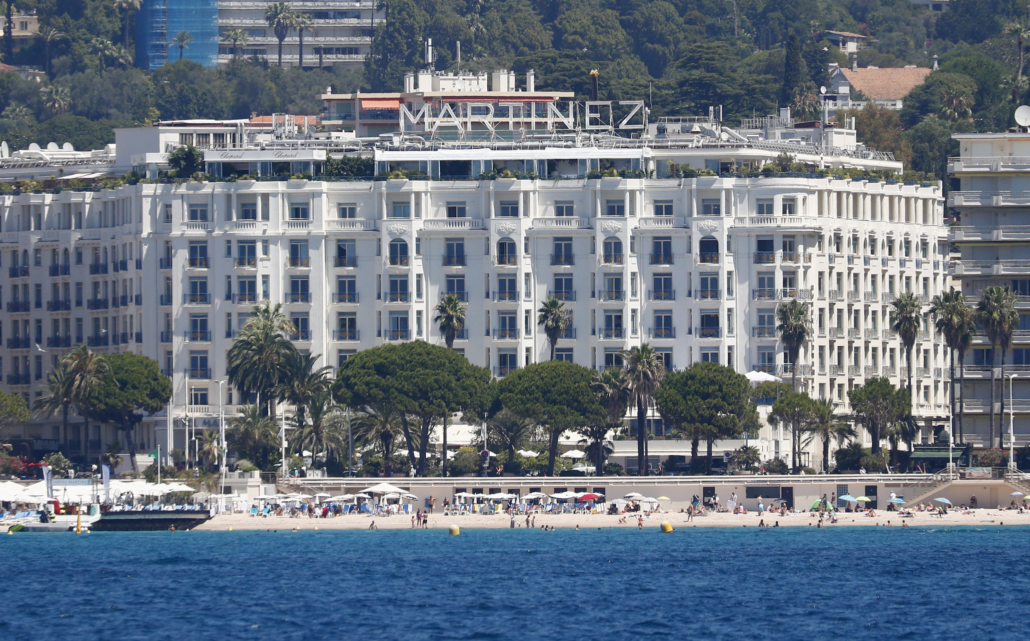 The 74th Cannes Film Festival - The Croisette - Cannes, France, July 5, 2021. A general view shows the Croisette with beaches and the Hotel Martinez before the start of the Cannes Film Festival.