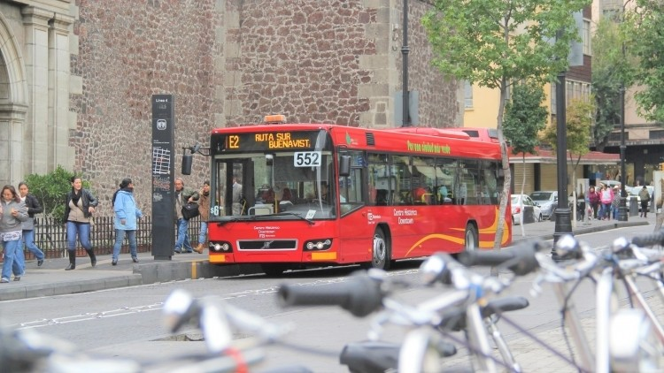 A bus is pictured on a street side.