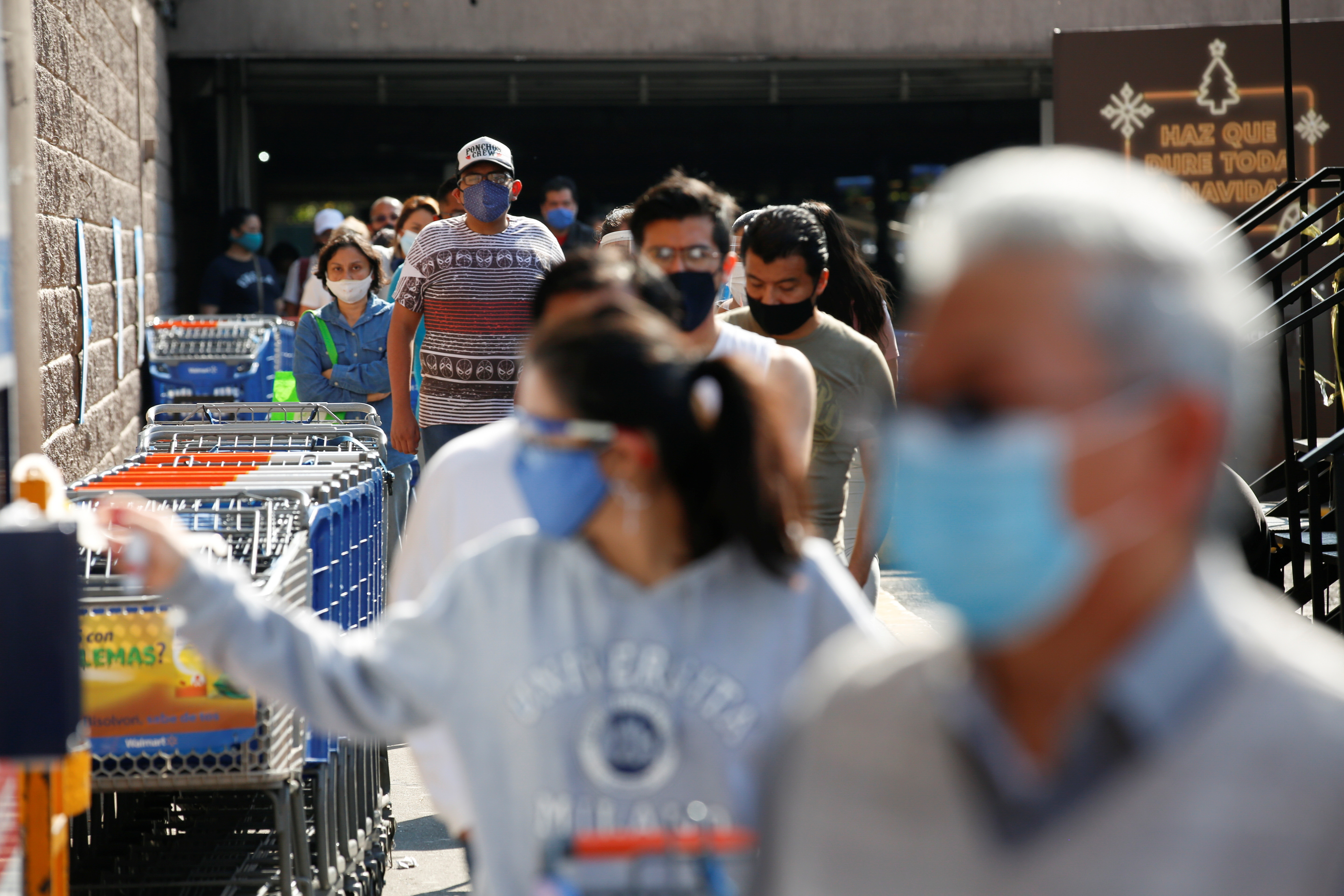 People shopping with masks on during the COVID-19 pandemic
