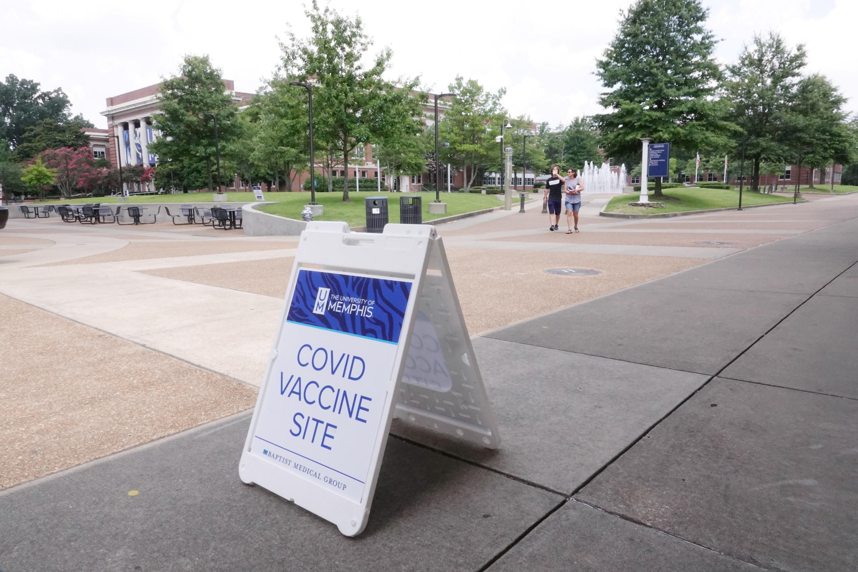 A coronavirus disease (COVID-19) vaccination site sign stands on the campus of the University of Memphis in Memphis, Tennessee, U.S., July 22, 2021. REUTERS/Karen Pulfer Focht - RC2UPO9JUGRG