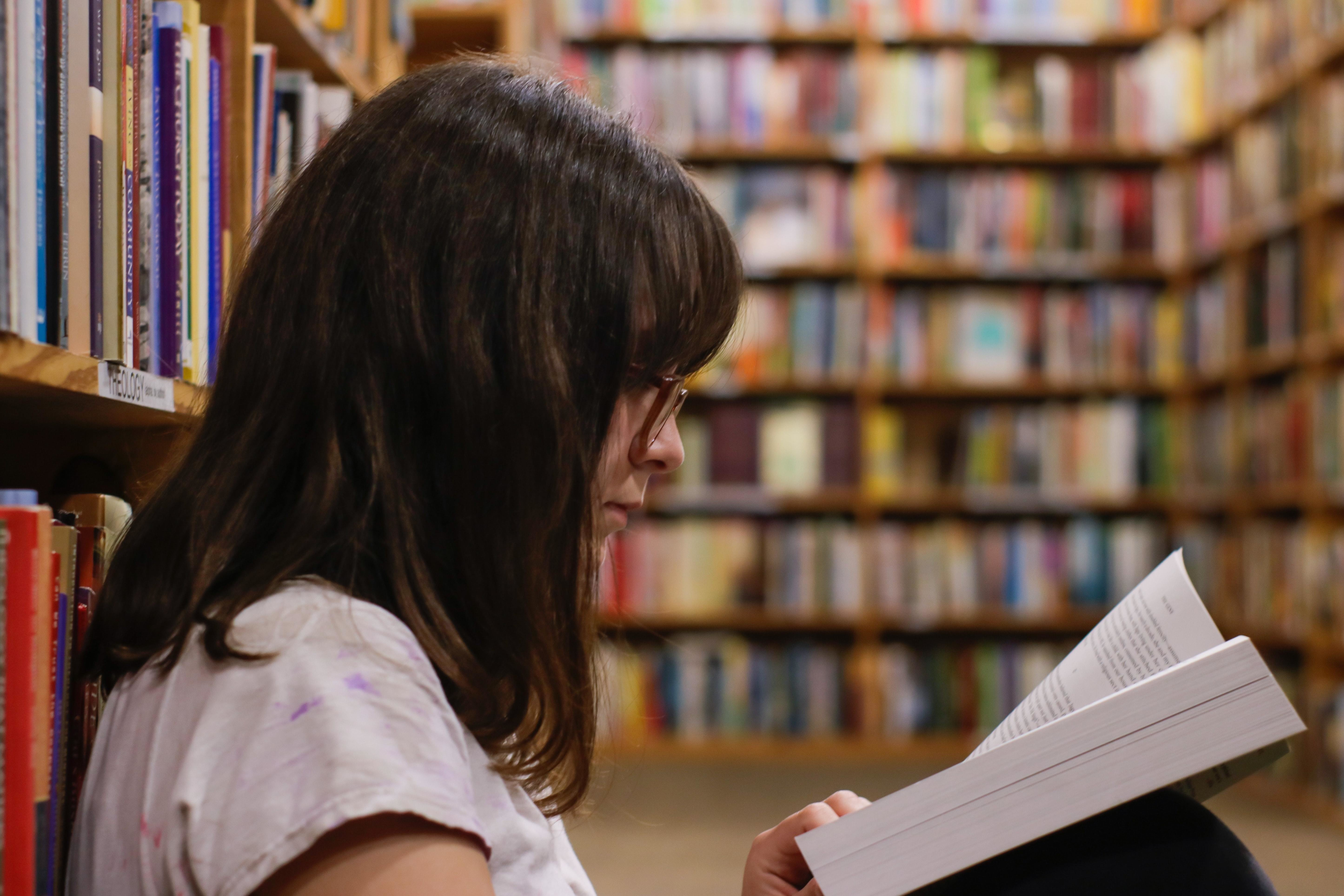 image of a young person reading a book