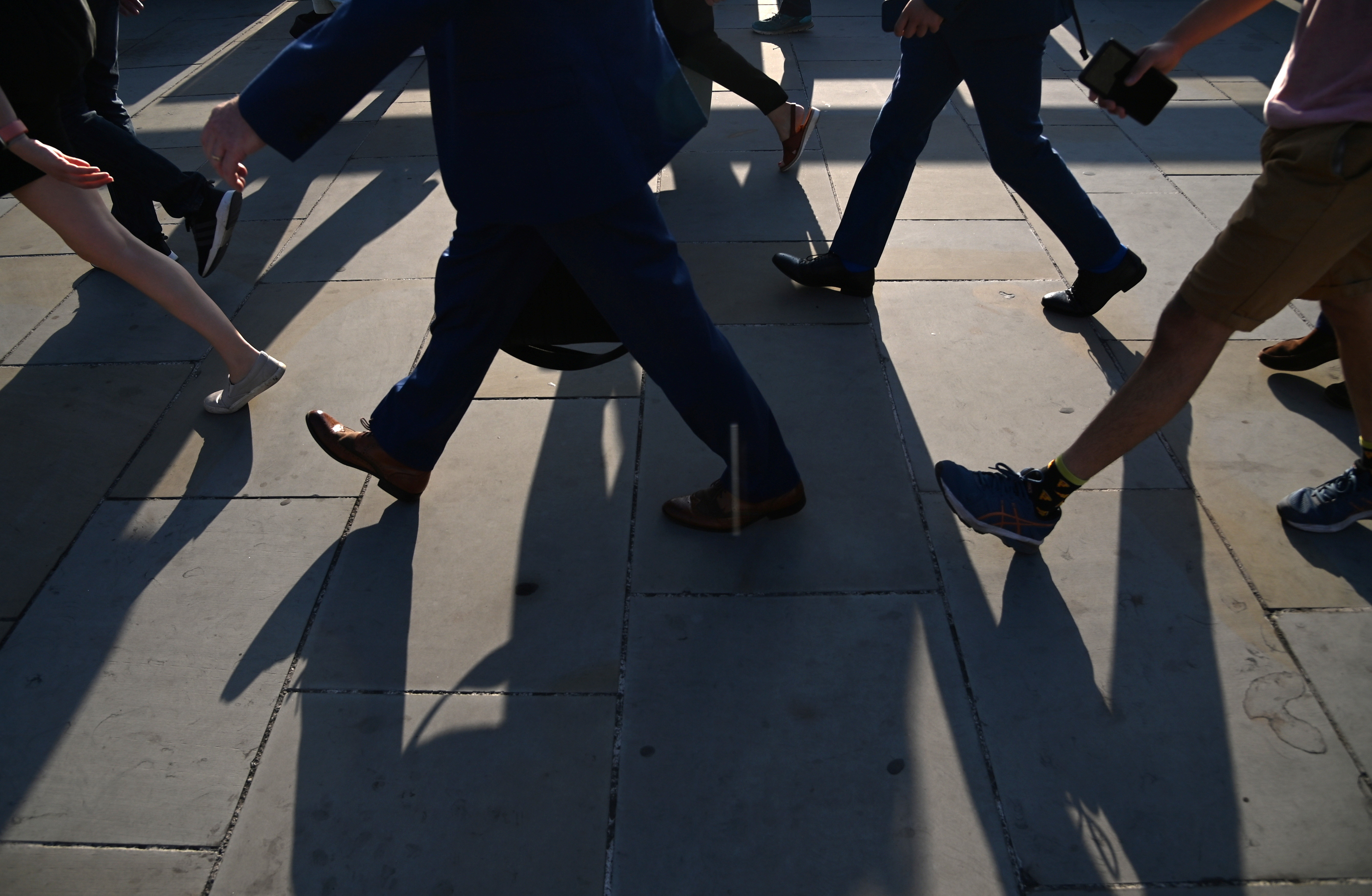 Workers cross London Bridge during the morning rush hour in London, Britain, September 8, 2021. REUTERS/Toby Melville - RC2KLP9SK2PX