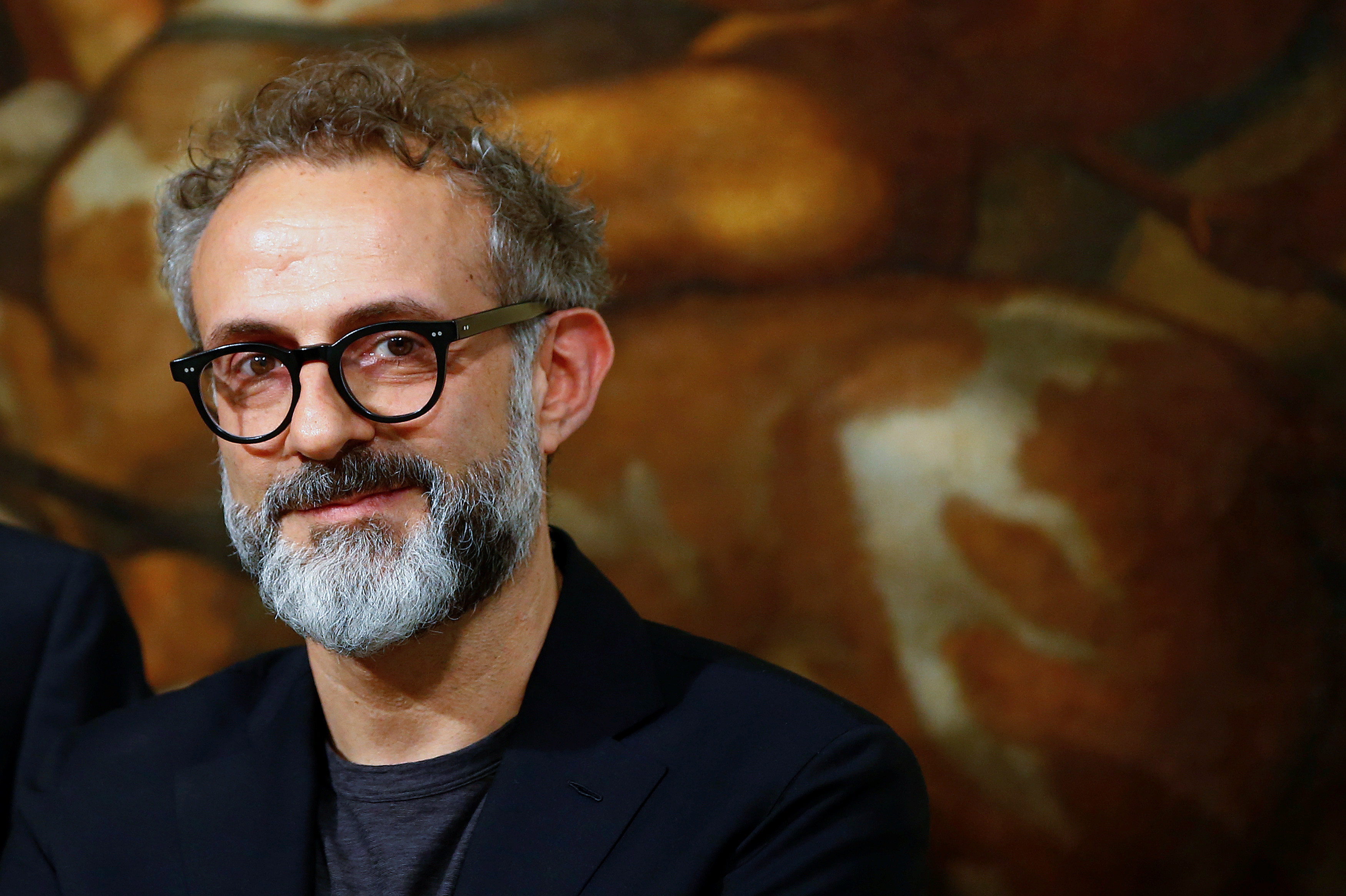 """Osteria Francescana's chef-owner Massimo Bottura looks on during a ceremony, to celebrate his victory in the """"World's 50 Best Restaurants 2016"""", at Chigi Palace in Rome, Italy June 20, 2016."""
