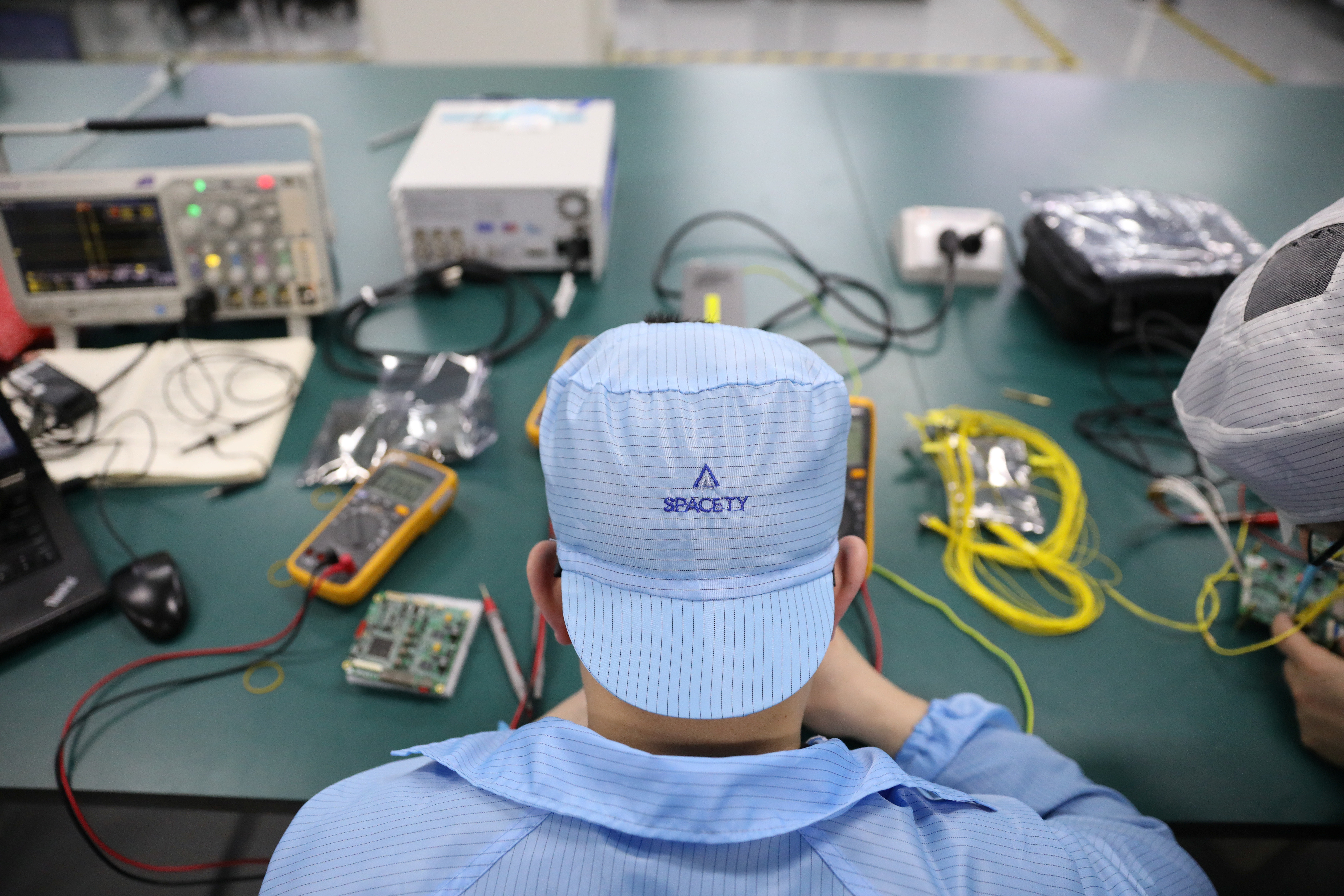 An engineer tests an electronic panel of a satellite at a lab of Spacety in Changsha, Hunan province, China, April 22, 2019. REUTERS/Aly Song - RC1E281AB0F0