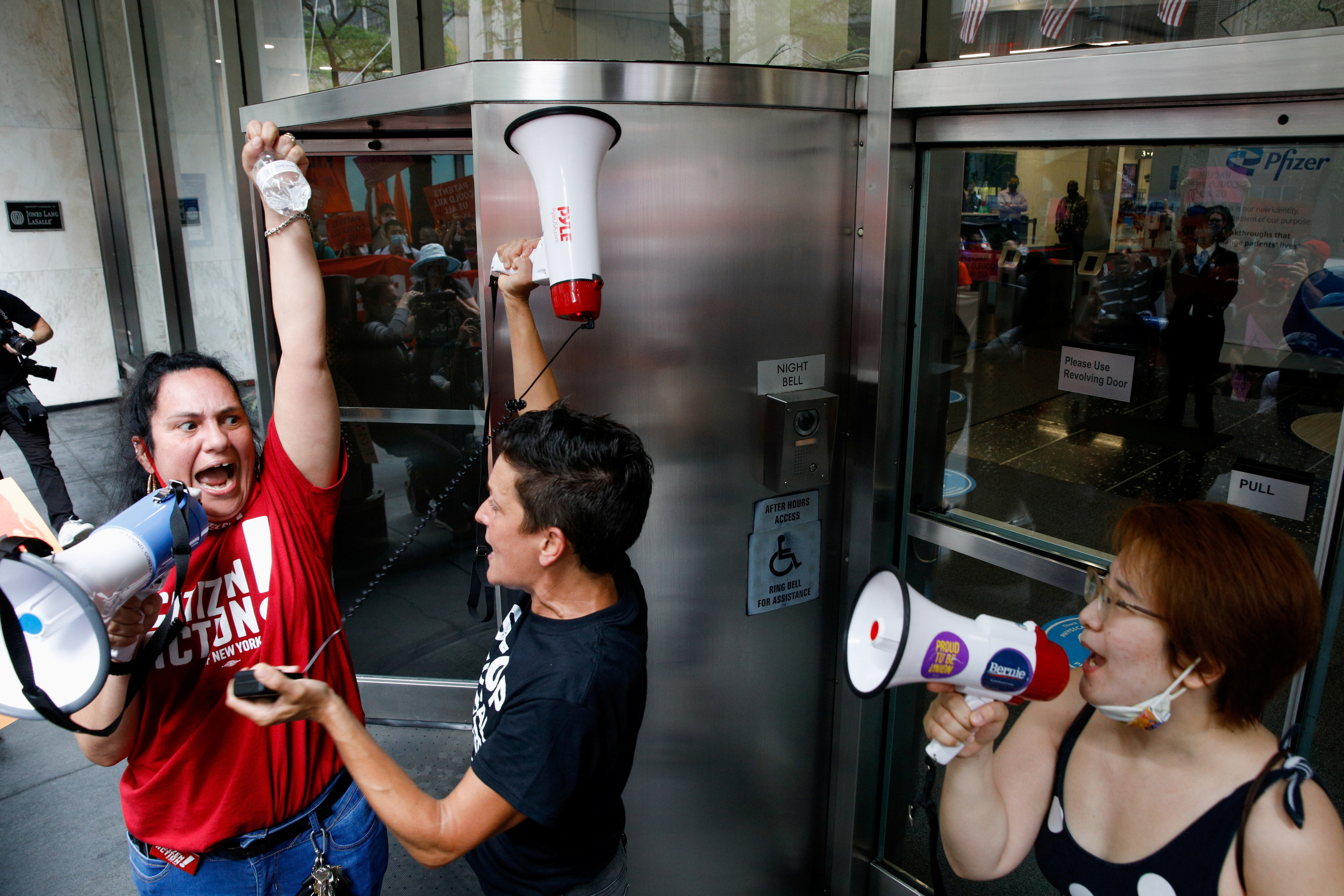 Activists rally for global access to the coronavirus disease (COVID-19) vaccine, outside Pfizer World Headquarters in New York City, New York, U.S., July 14, 2021.