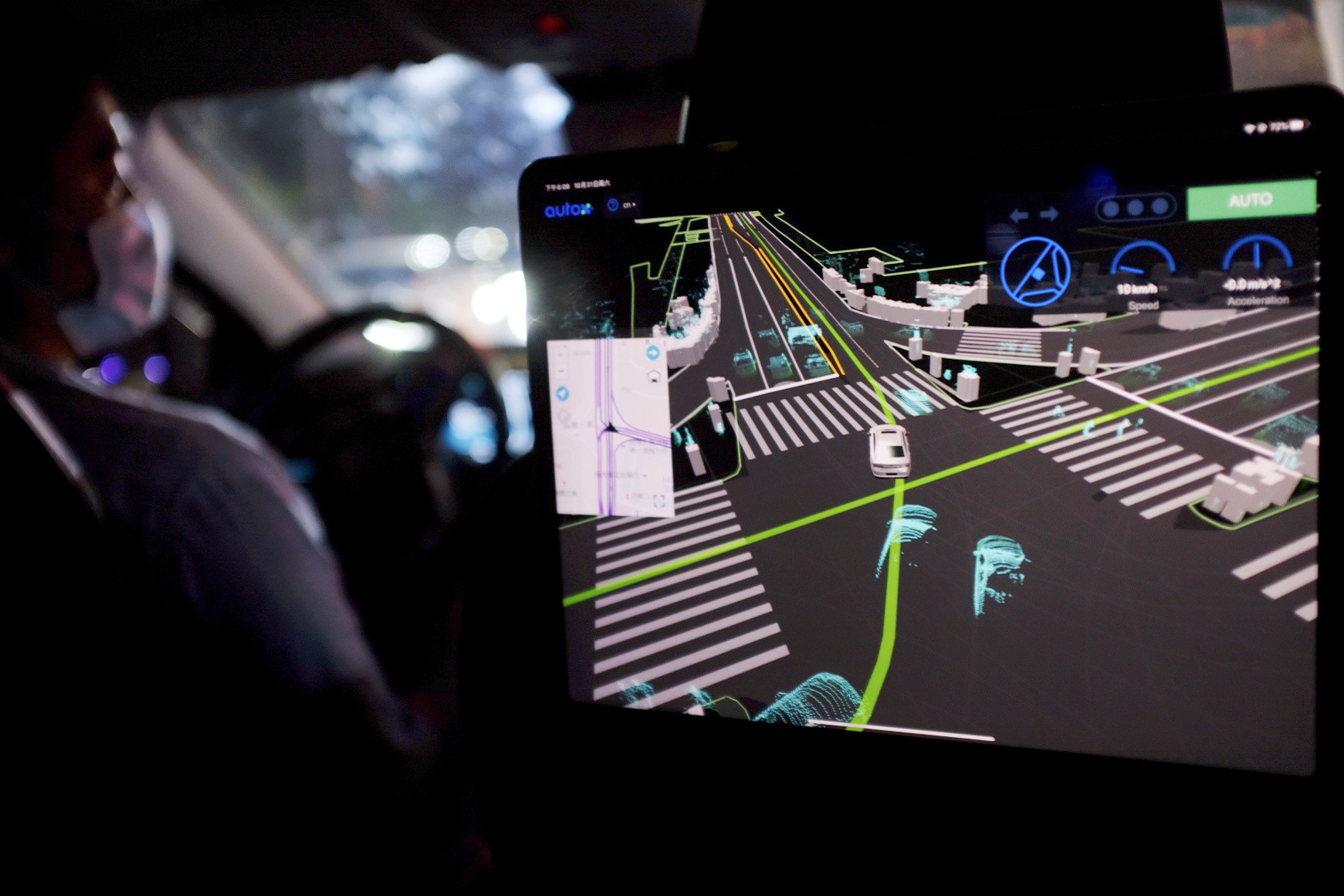 A screen showing a car's driving route is seen in a test vehicle by Alibaba-backed autonomous driving startup AutoX, in the city center of Shenzhen, Guangdong province, China October 31, 2020. Picture taken October 31, 2020. REUTERS/Yilei Sun - RC2VUJ942305