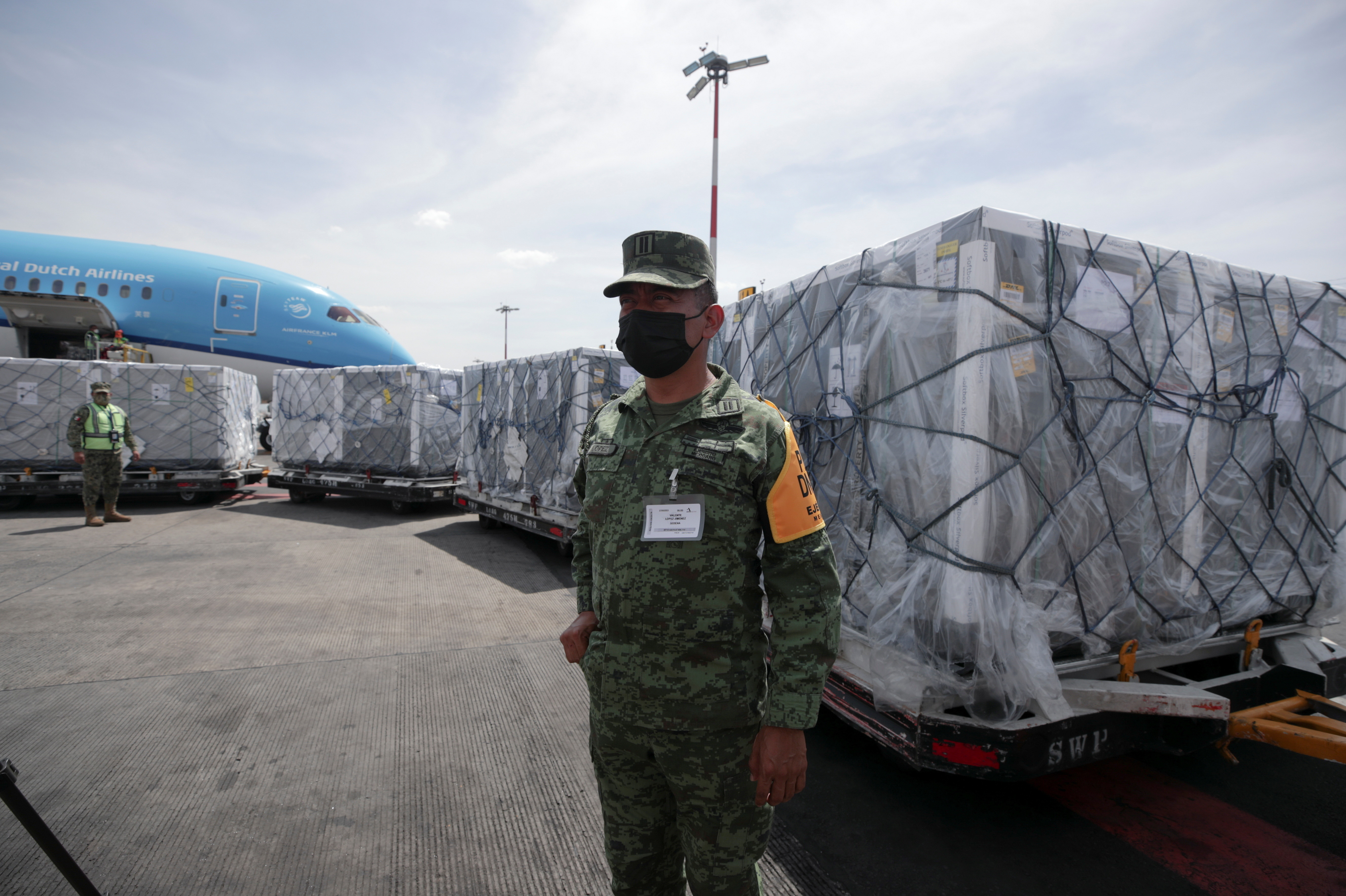 A member of the National Guard looks on as a batch of AstraZeneca coronavirus disease (COVID-19) vaccines, delivered under the COVAX scheme, is unloaded from a KLM Boeing 787 at Benito Juarez International Airport in Mexico City, Mexico May 27, 2021. REUTERS/Henny Romero - RC2LON9NCGN9