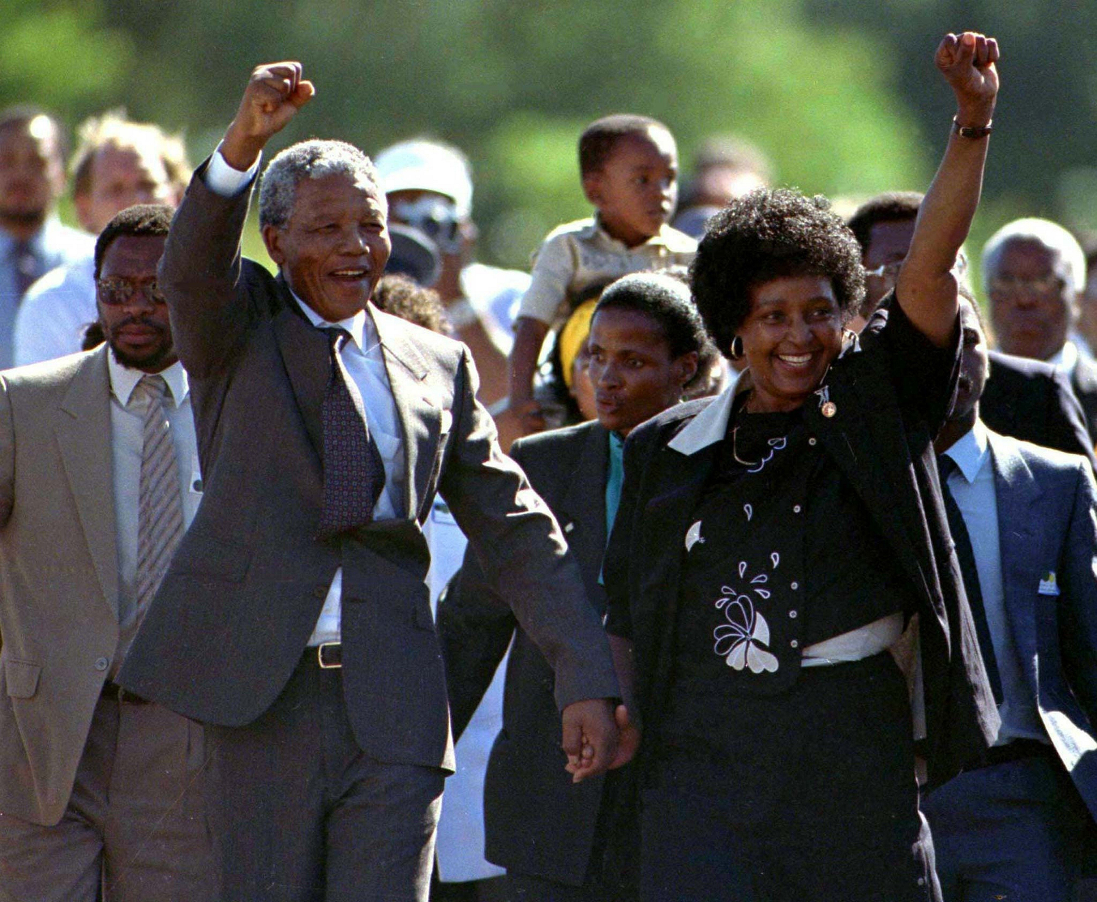 Nelson Mandela, accompanied by his wife Winnie, walks out of the Victor Verster prison near Cape Town