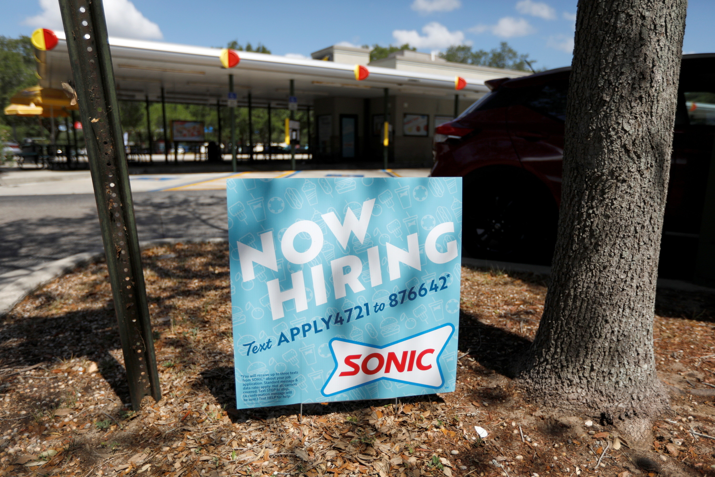 """A Sonic restaurant displays a """"Now Hiring"""" sign in Tampa, Florida, U.S., June 1, 2021.  REUTERS/Octavio Jones - RC2SRN9JYTL2"""