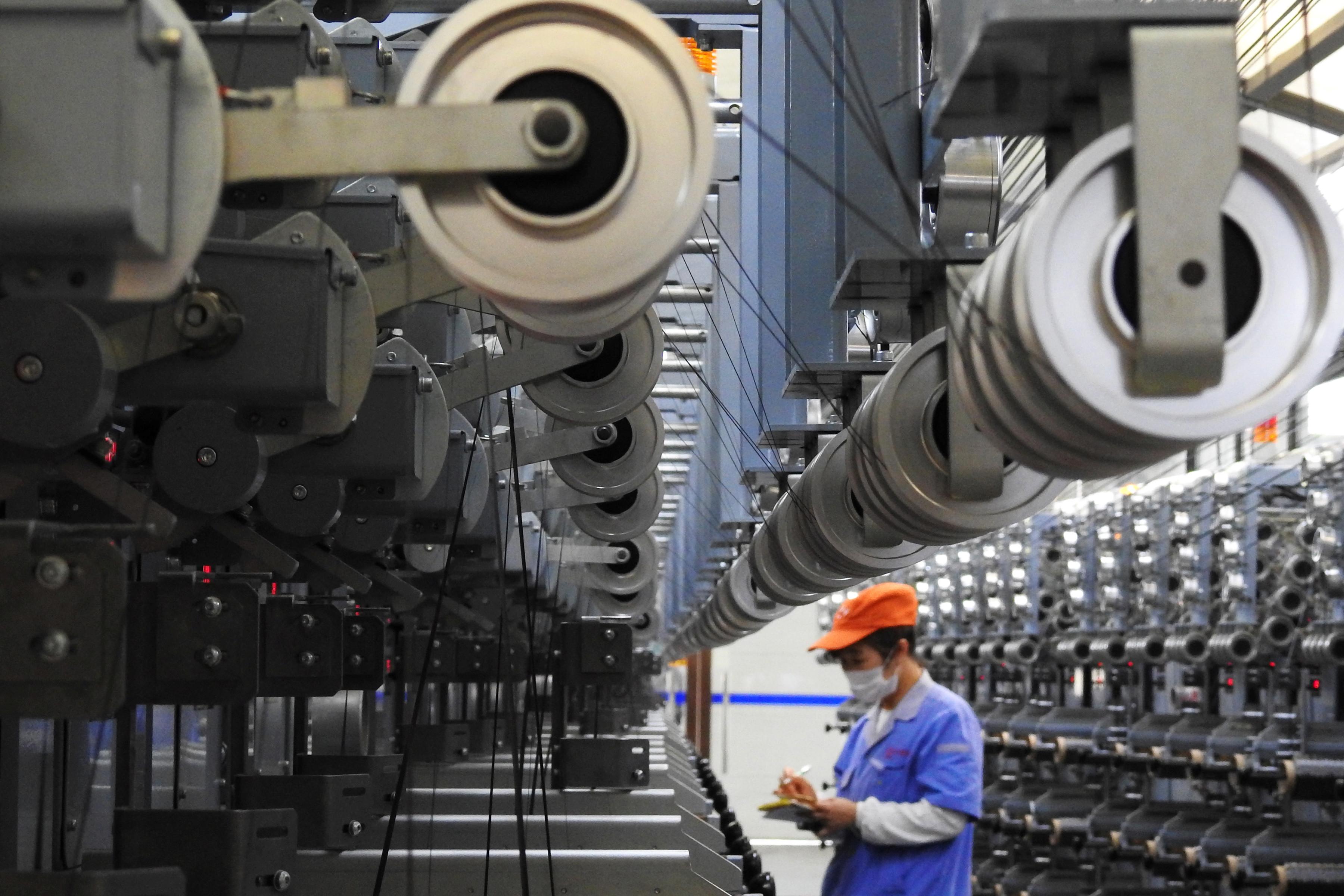 A picture of a production line of carbon fibres.