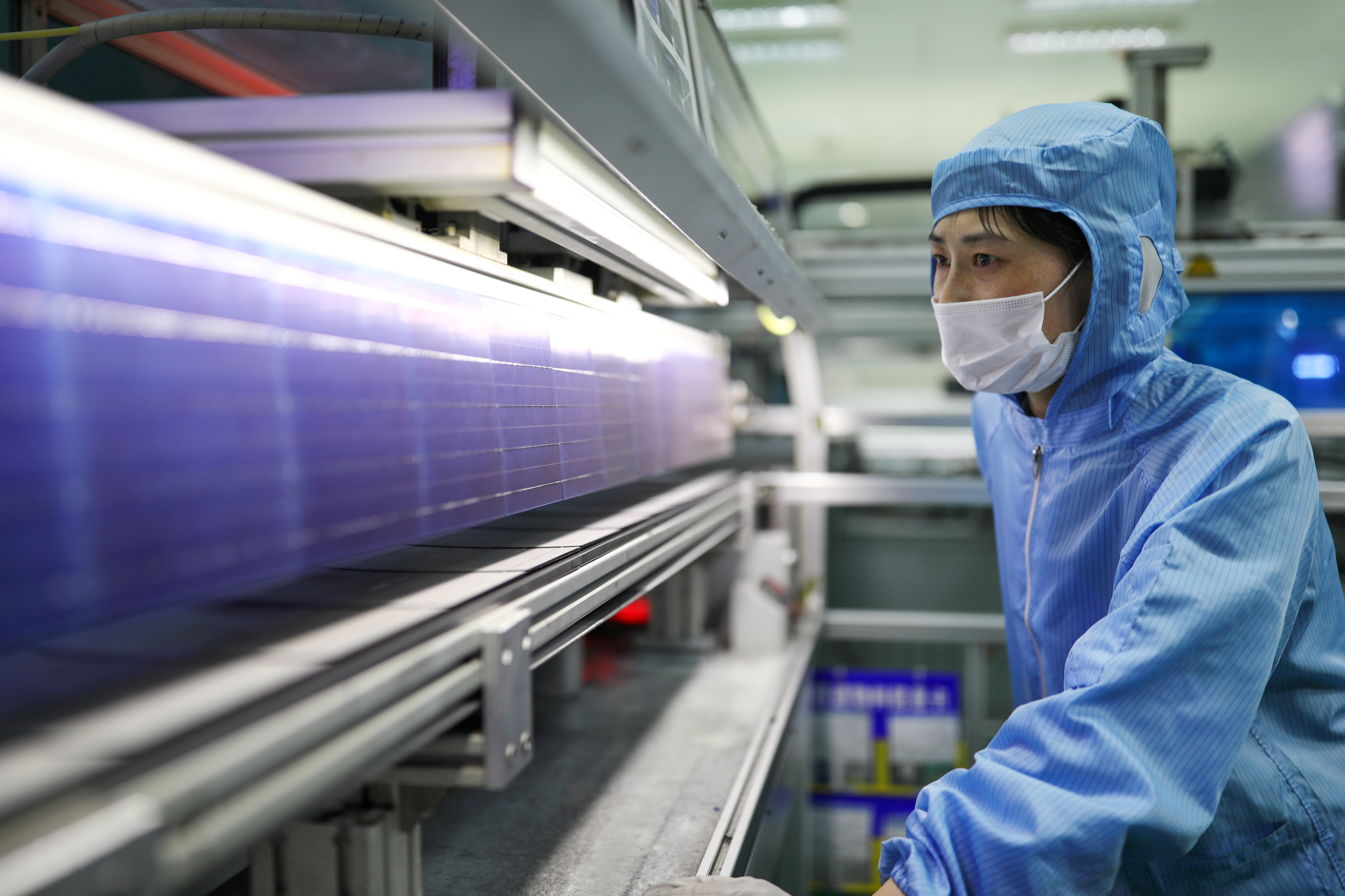 An employee works at a solar panel production line of Shenzhou New Energy Co Ltd in Lianyungang, Jiangsu province, China March 15, 2018. Picture taken March 15, 2018