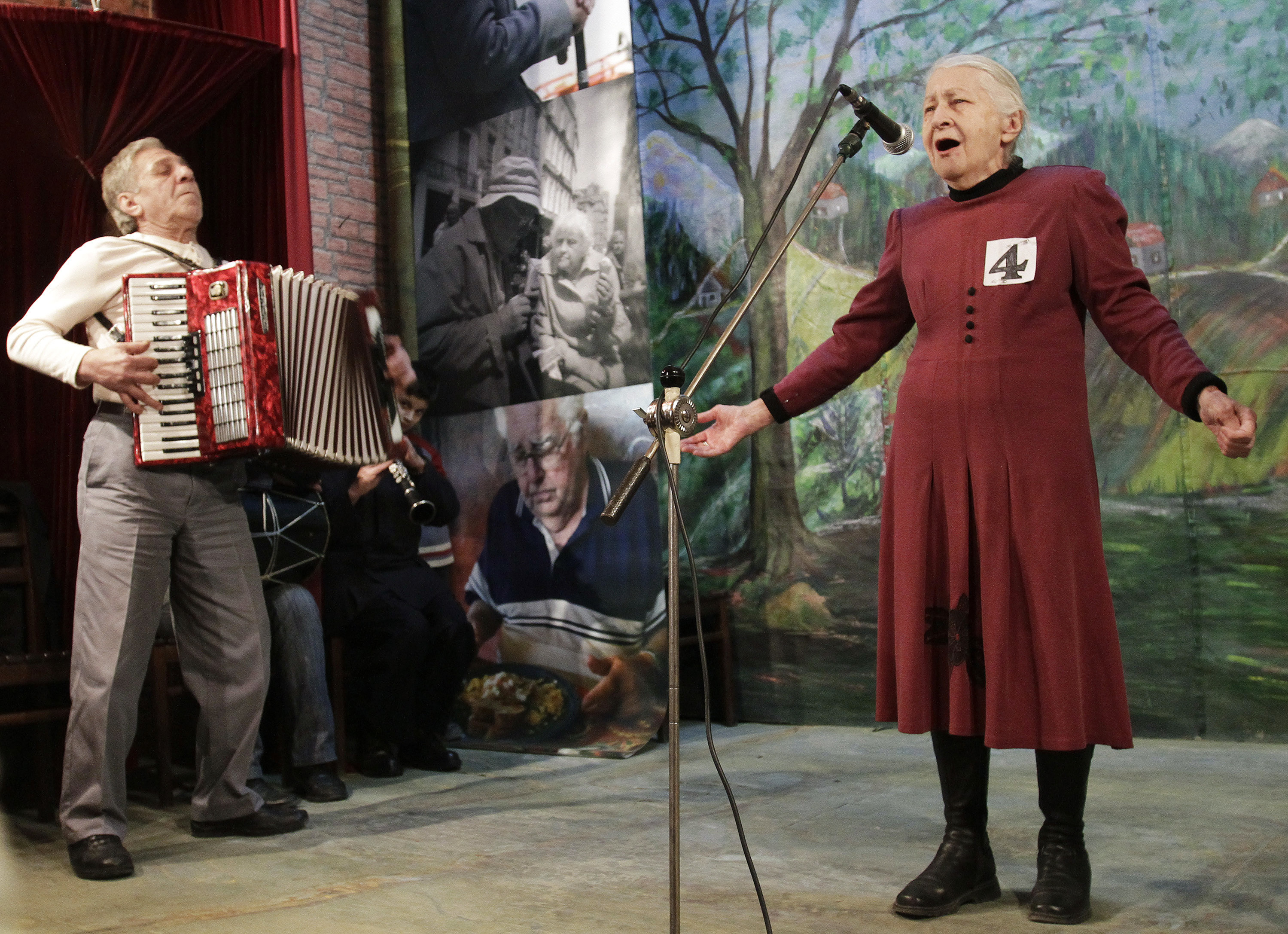 "Tsiuri Kakabadze (R), 80, performs during the ""Super Grandmother and Super Grandfather"" contest in Tbilisi January 5, 2011. Twenty-four participants aged over 70 from all over Georgia attended the contest. REUTERS/David Mdzinarishvili (GEORGIA - Tags: SOCIETY ODDLY IMAGES OF THE DAY) - GM1E716051R01"