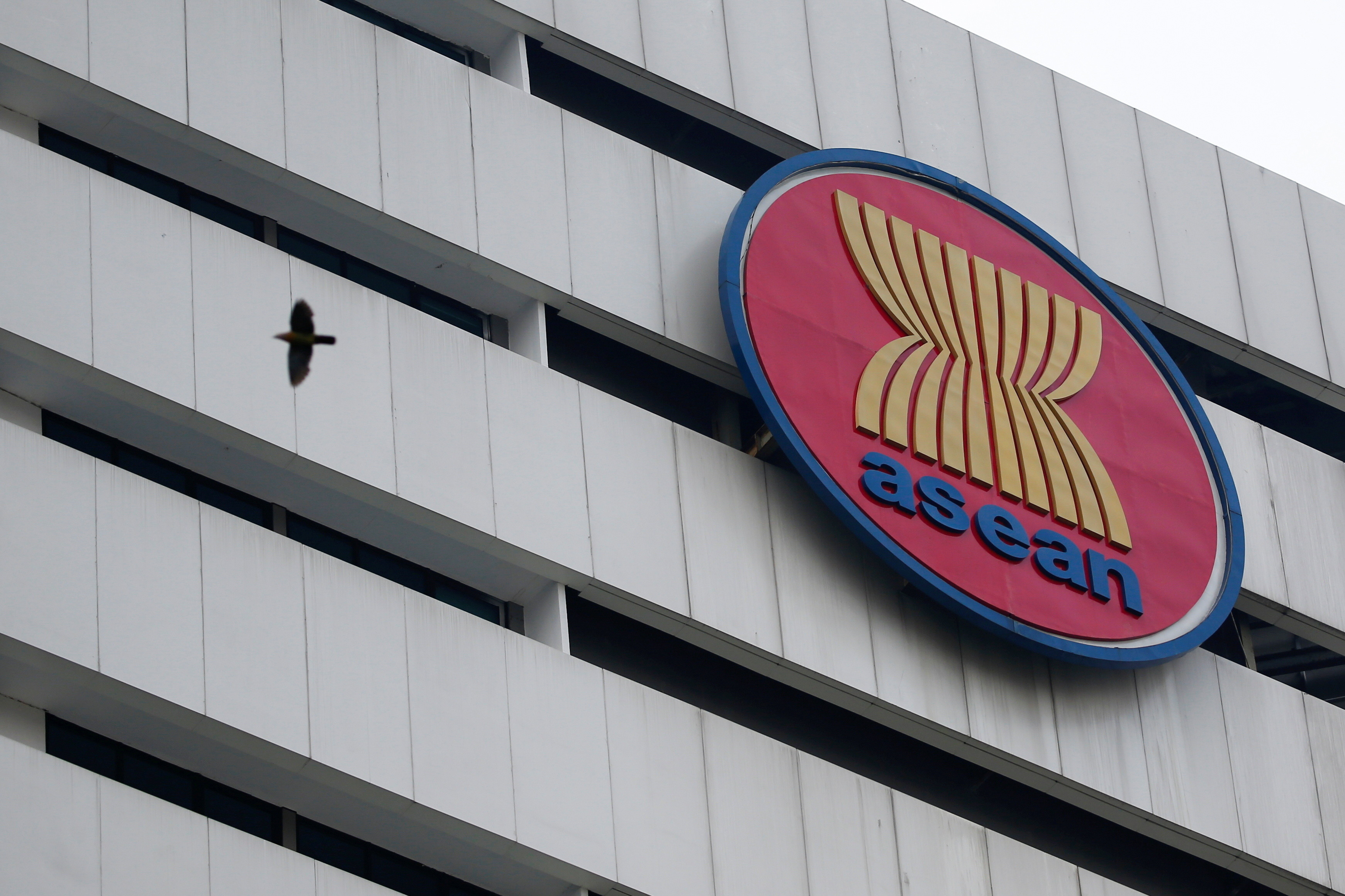 A bird flies near the Association of Southeast Asian Nations (ASEAN) secretariat building, ahead of the ASEAN leaders' meeting in Jakarta, Indonesia, April 23, 2021. REUTERS/Willy Kurniawan - RC2K1N9C16DM
