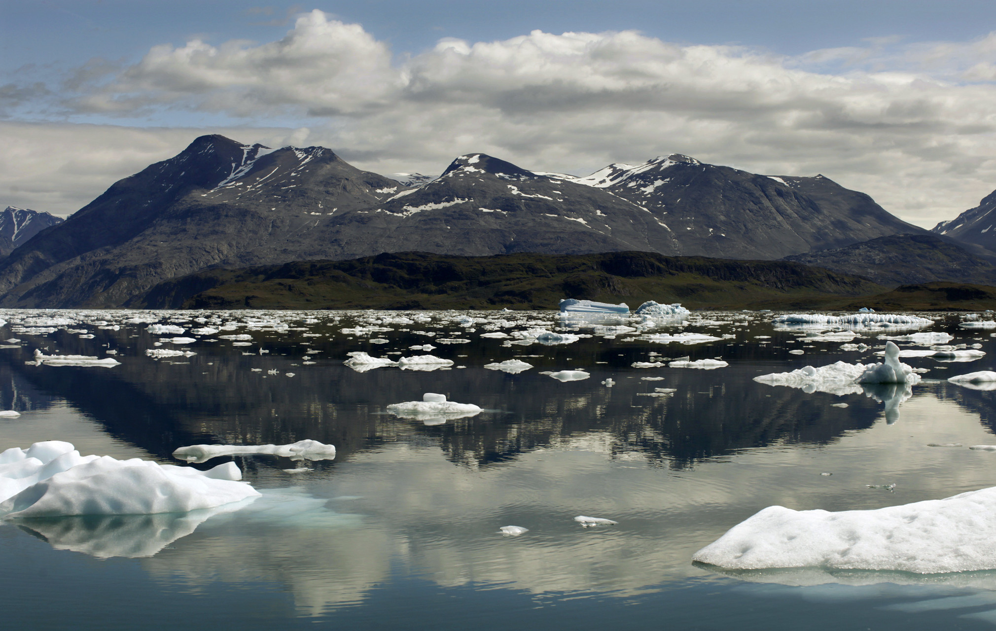 Icebergs are reflected in the waters of Eriks Fjord near the town of Narsarsuaq in southern Greenland
