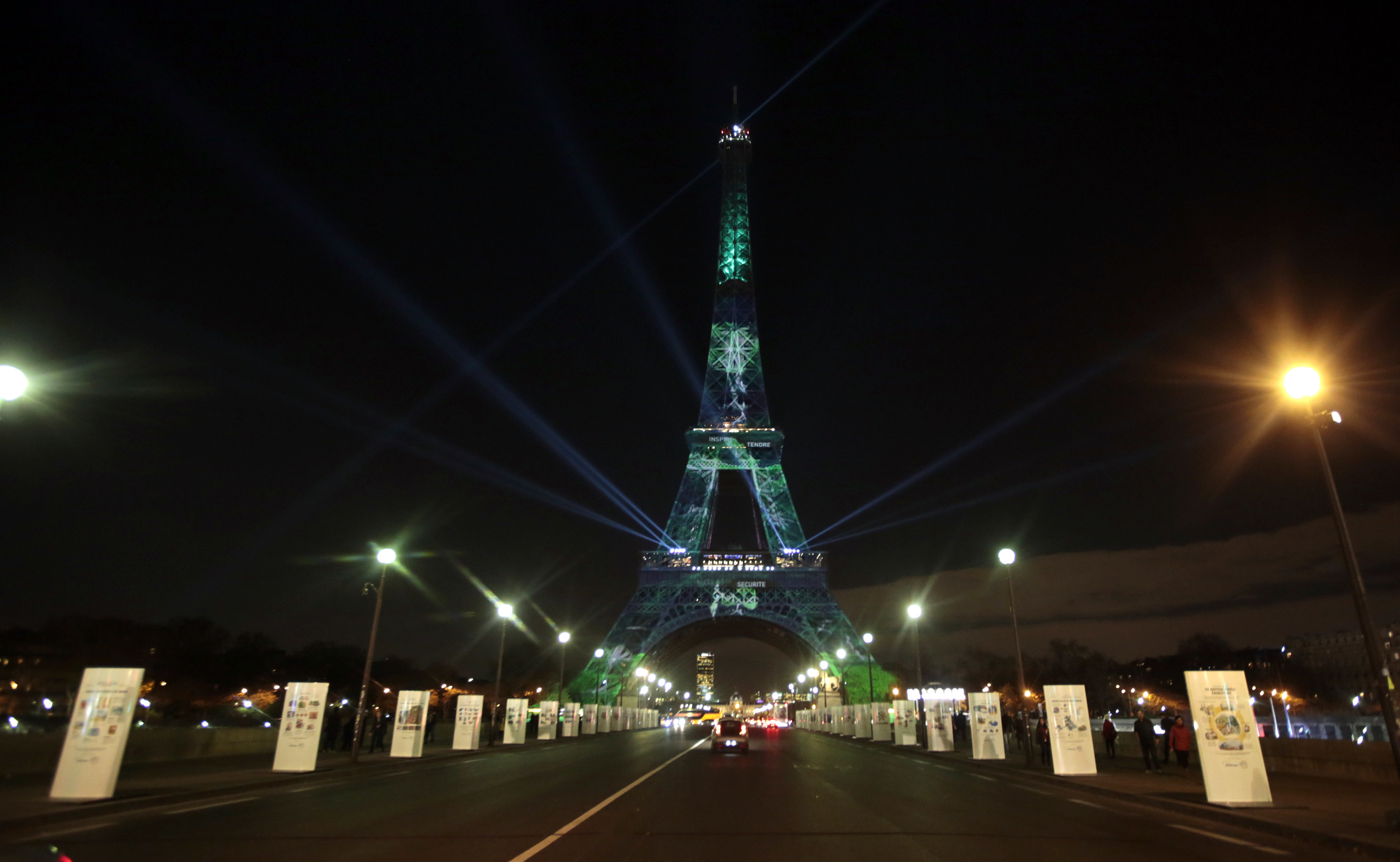 The Eiffel Tower is lit with green lights as part of the events in the French capital to mark the World Climate Change Conference 2015 (COP21), in Paris, France, December 2, 2015.   REUTERS/Eric Gaillard  - LR2EBC21ESFJJ
