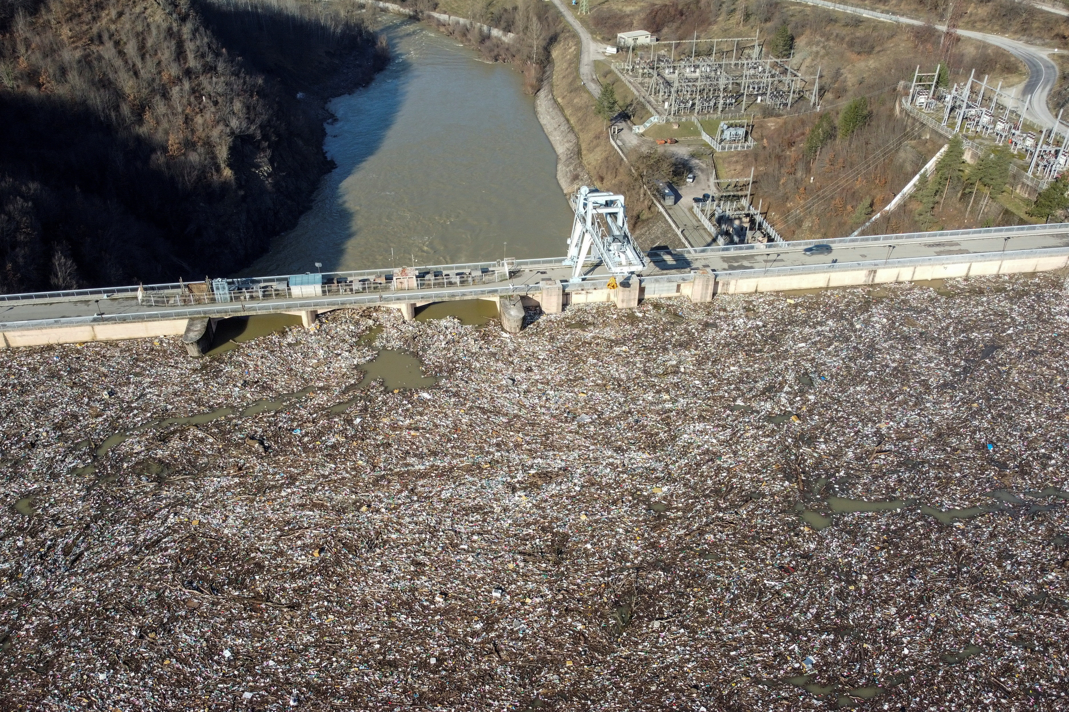 General view of plastic trash littering the polluted Potpecko Lake near a dam's hydroelectric plant, in Serbia January 5, 2021. Picture taken with a drone on January 5, 2021. REUTERS/Branko Filipovic - RC2E2L9C9NRE