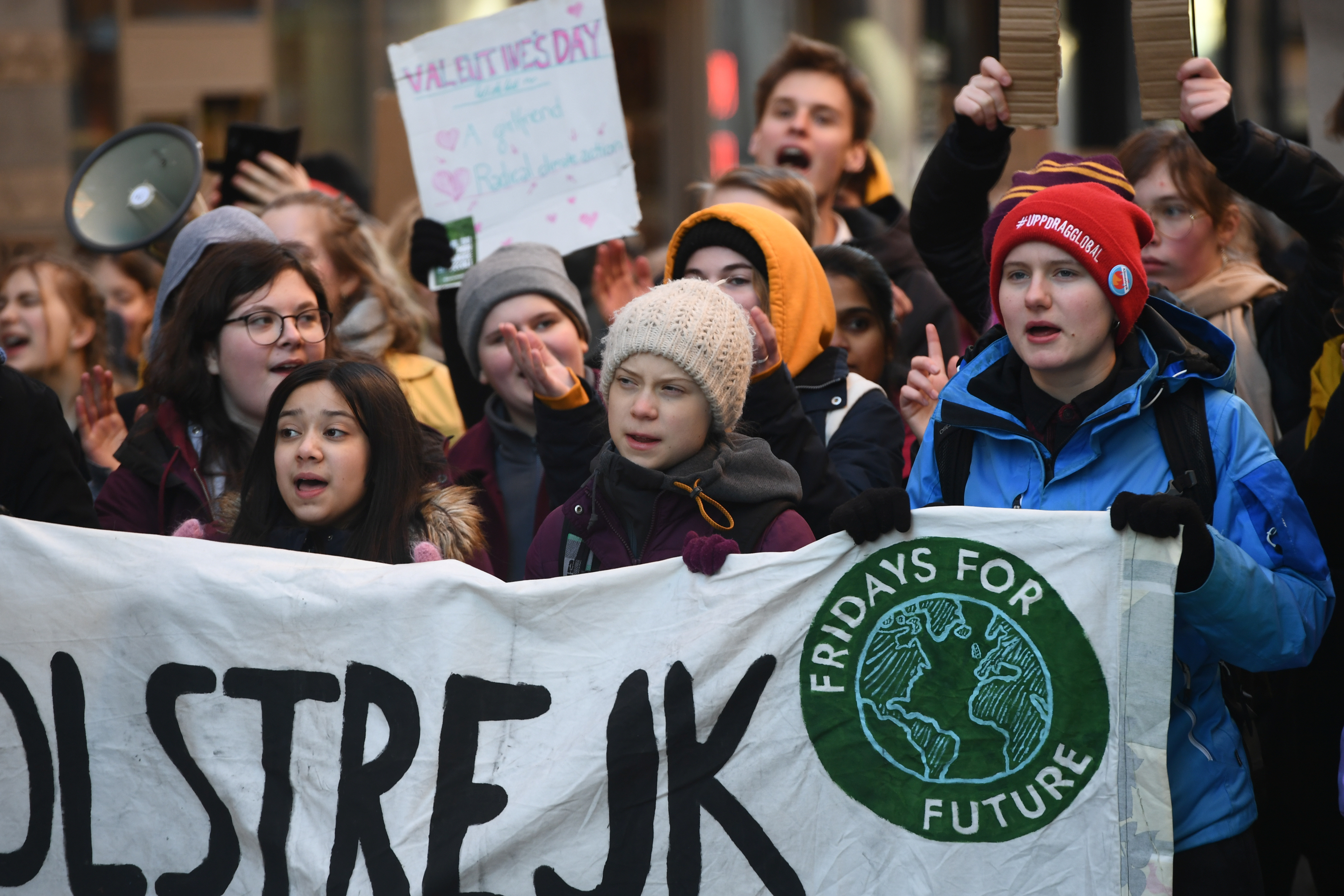 """Swedish environmental activist Greta Thunberg and other protesters attend the weekly """"Fridays For Future"""" climate strike, at Mynttorget in Stockholm, Sweden February 14, 2020   TT News Agency/Ali Lorestani via REUTERS      ATTENTION EDITORS - THIS IMAGE WAS PROVIDED BY A THIRD PARTY. SWEDEN OUT. NO COMMERCIAL OR EDITORIAL SALES IN SWEDEN. - RC2D0F93I96I"""