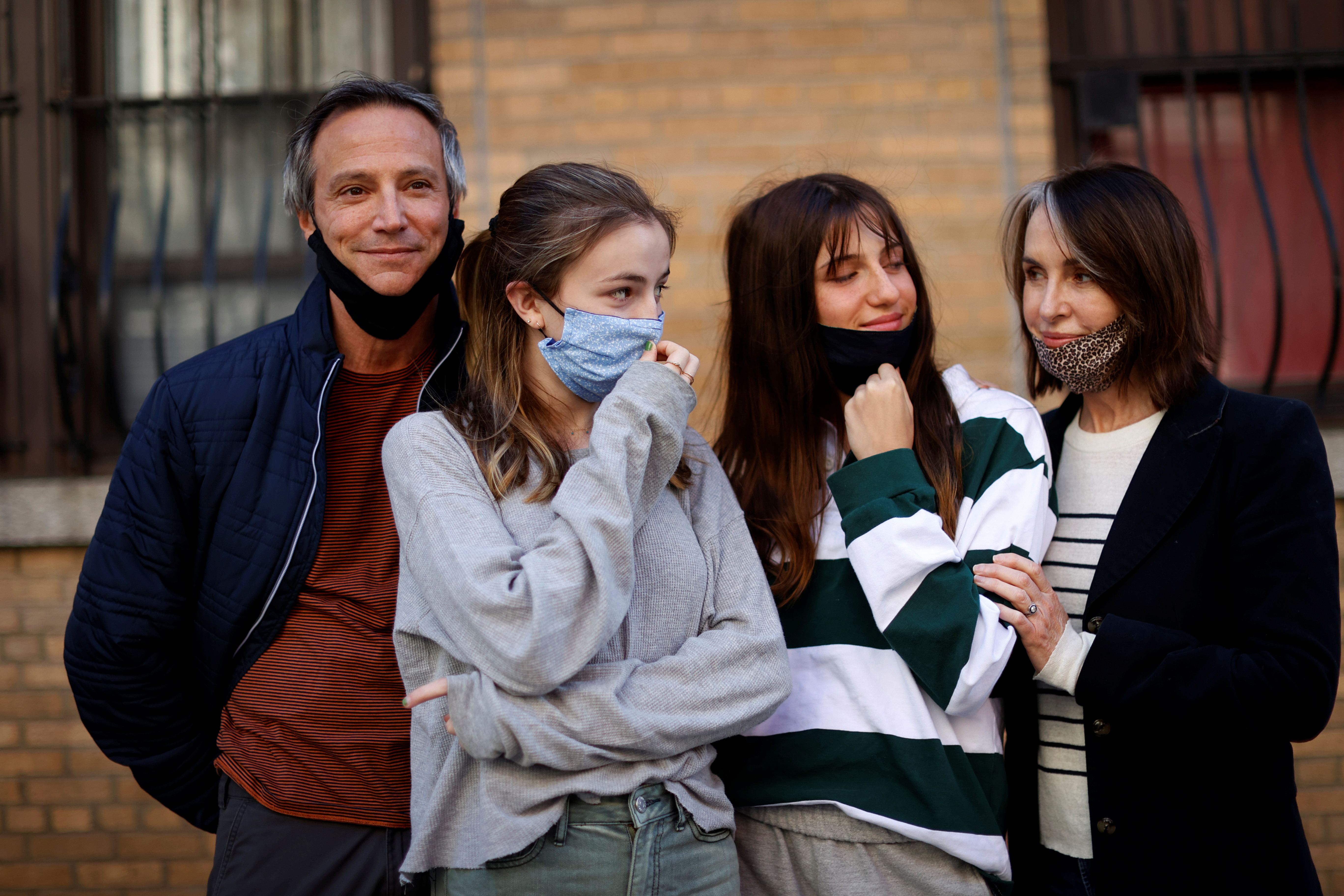 Maree Johnson-Baruch (R), a Broadway performer, poses with her family, husband Jason and teenage daughters Audra and Helena, all of whom have recovered from becoming sick with the coronavirus disease (COVID-19), outside their home in Manhattan in New York City, New York, U.S., May 5, 2020. Picture taken May 5, 2020. REUTERS/Mike Segar - RC2MJG9H06L4