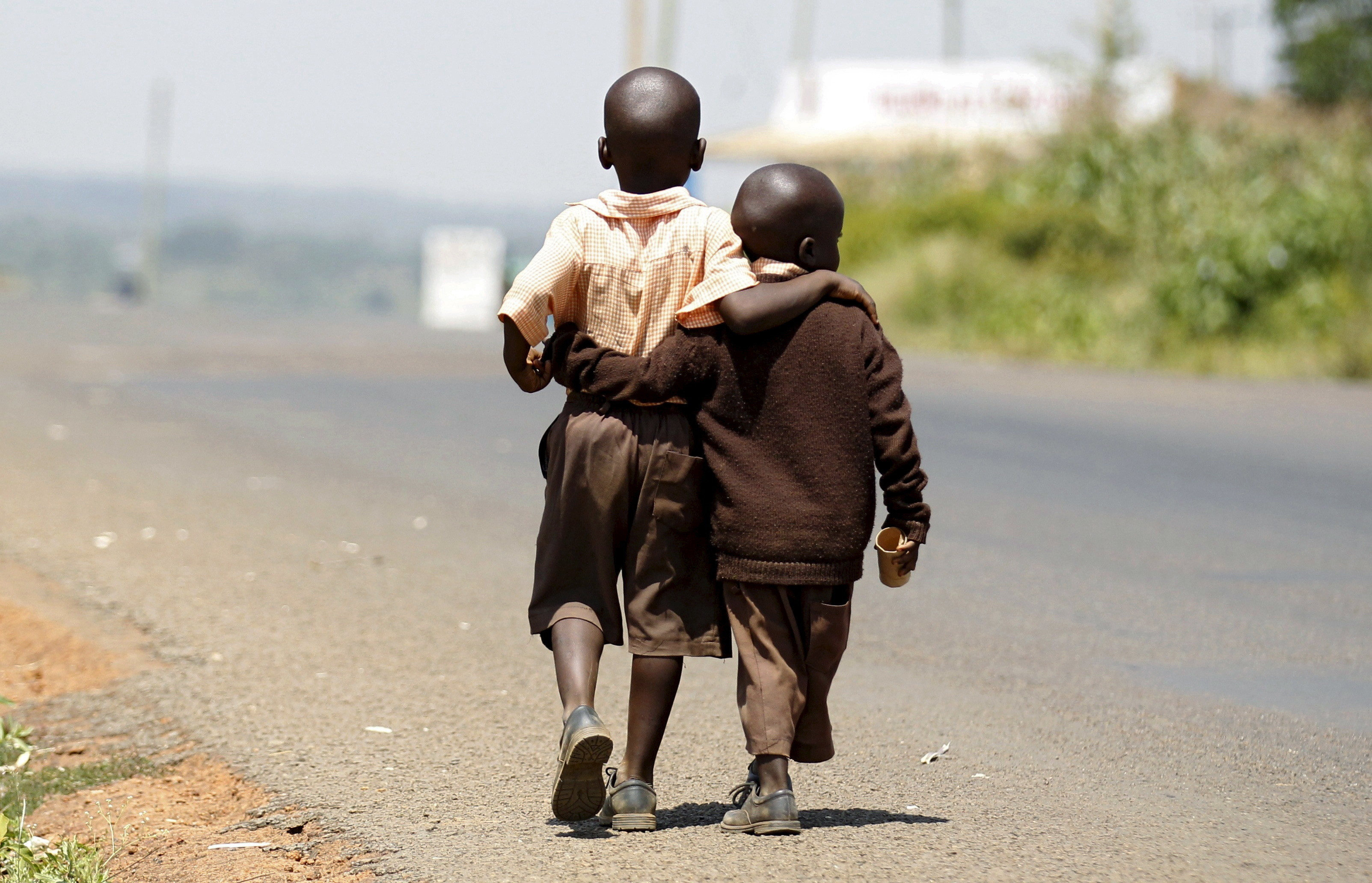 image of children walking home from school in the village of Kogelo, west of Kenya's capital Nairobi