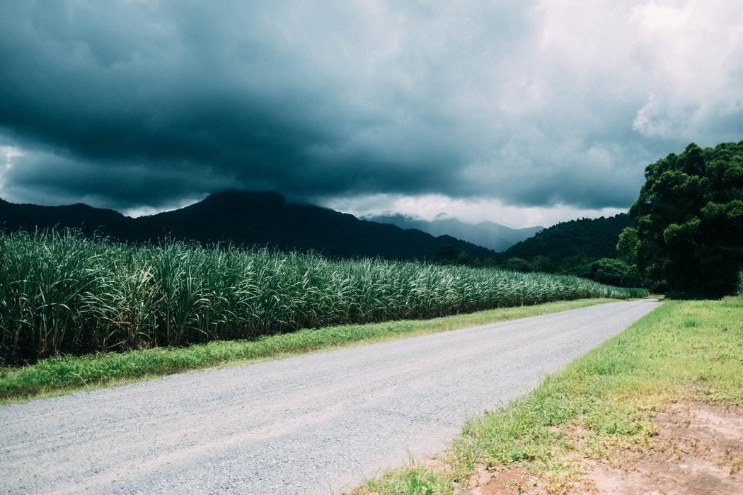 A tropical storm seen over a farm.