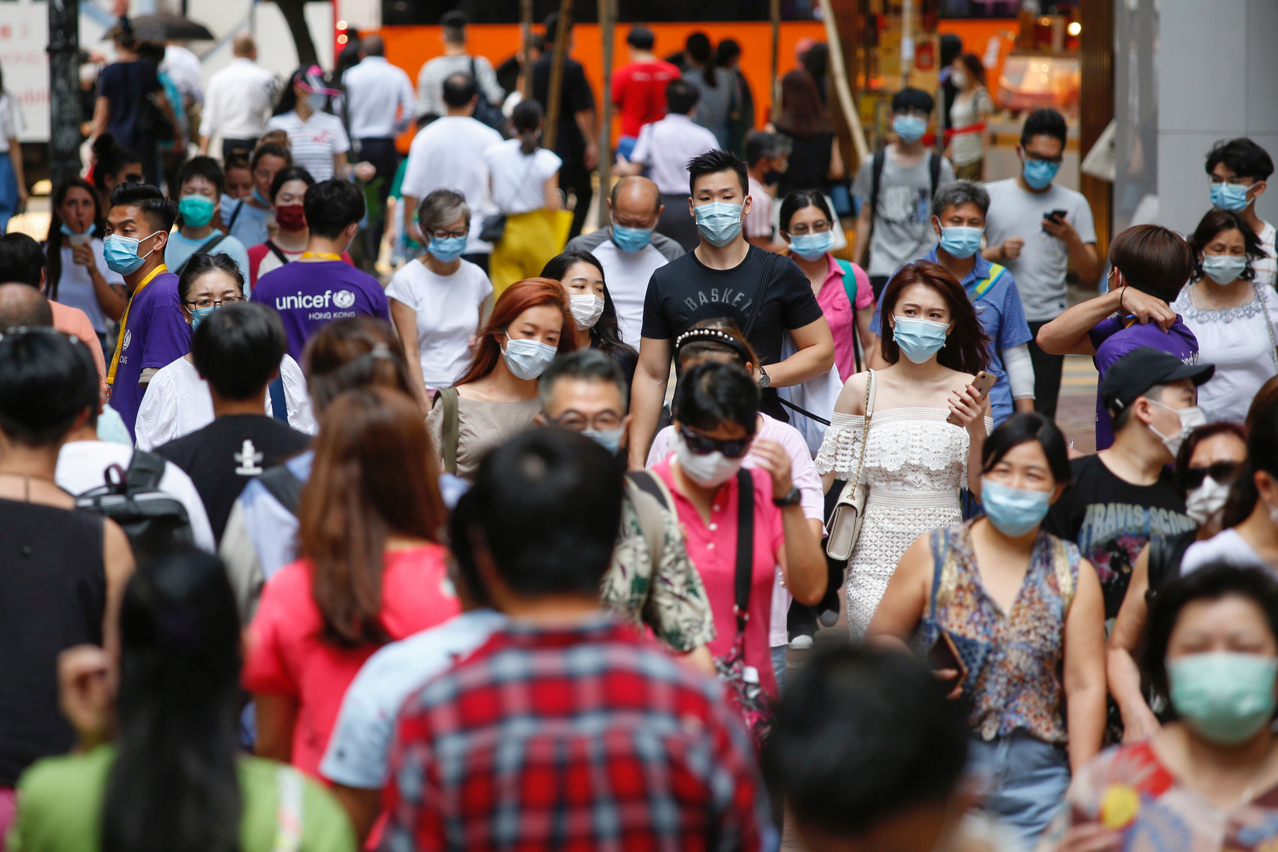 People wear surgical masks following the coronavirus disease (COVID-19) outbreak in Hong Kong, China July 17, 2020. REUTERS/Tyrone Siu - RC2XUH9ASMLF
