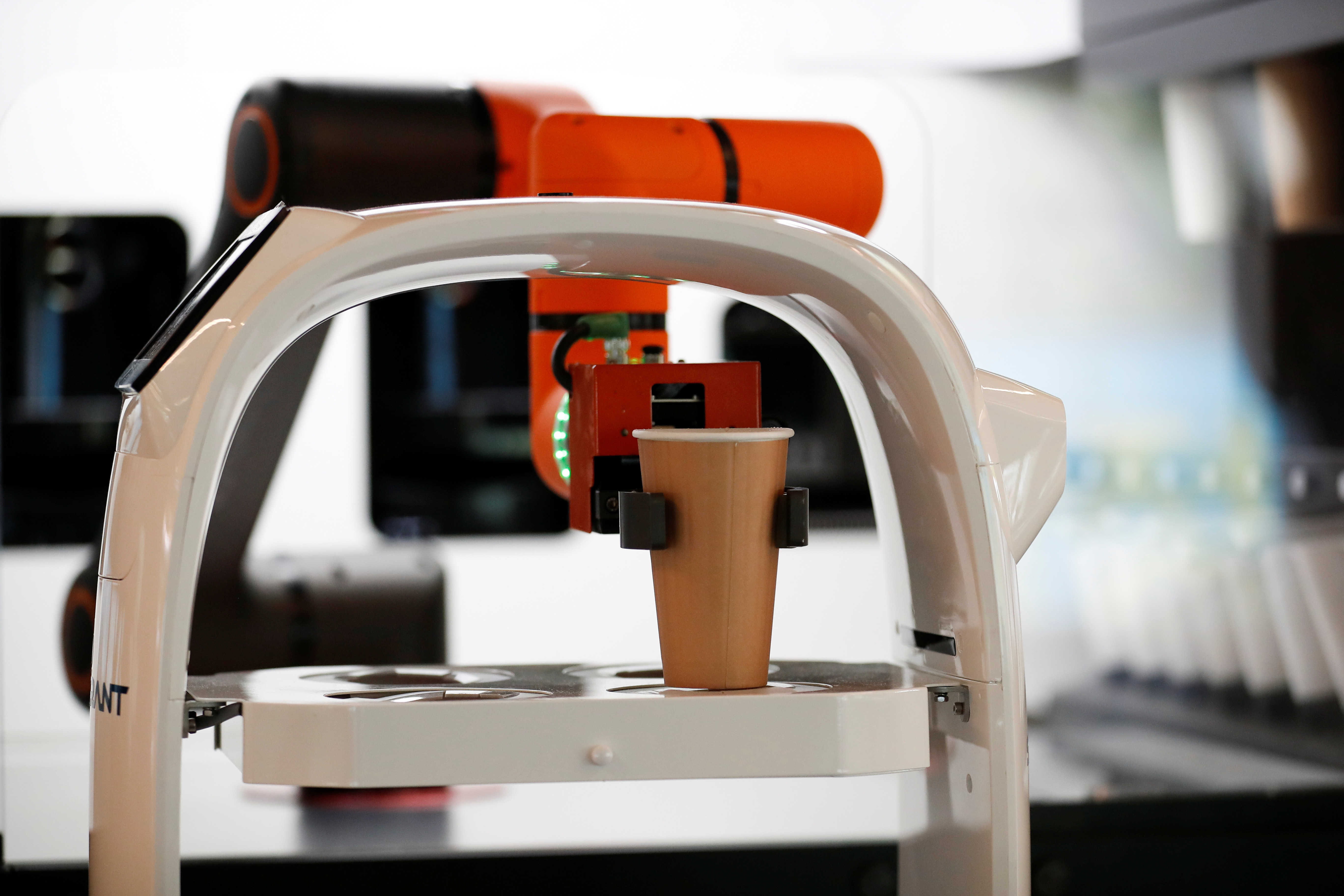 A robot that takes orders, makes coffee and brings the drinks straight to customers at their seats is seen at a cafe in Daejeon, South Korea, May 25, 2020. REUTERS/Kim Hong-Ji - RC2FVG9ZIY1S