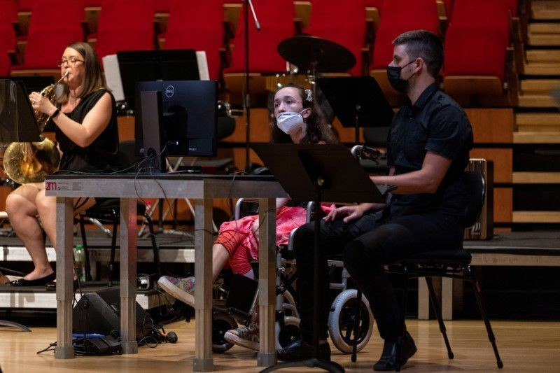 """Alexandra Kerlidou, who has cerebral palsy, plays the """"Eyeharp"""", a gaze-controlled digital software that allows people with disabilities to play music"""