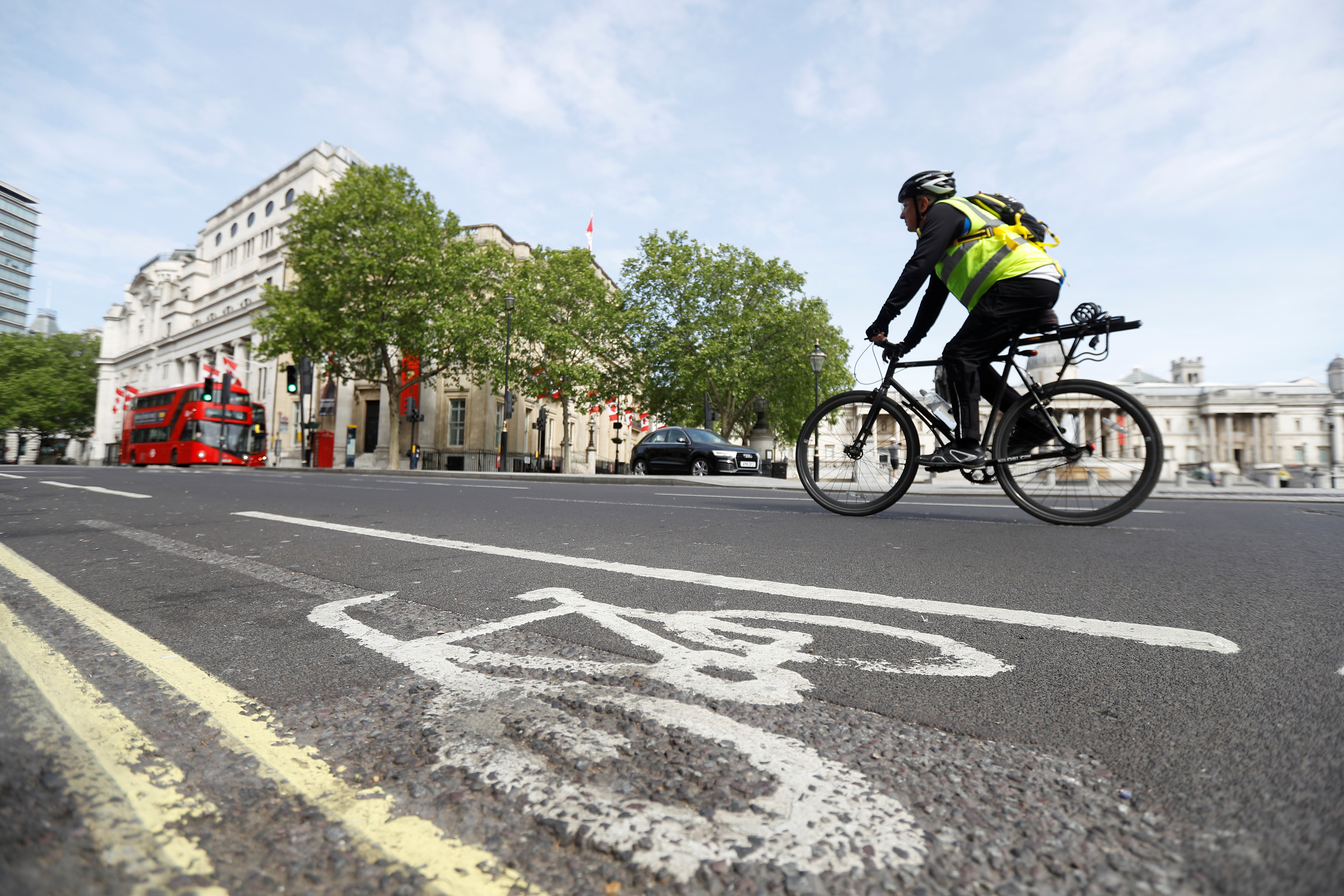 A man cycles on a cycle lane in Trafalgar Square in London.