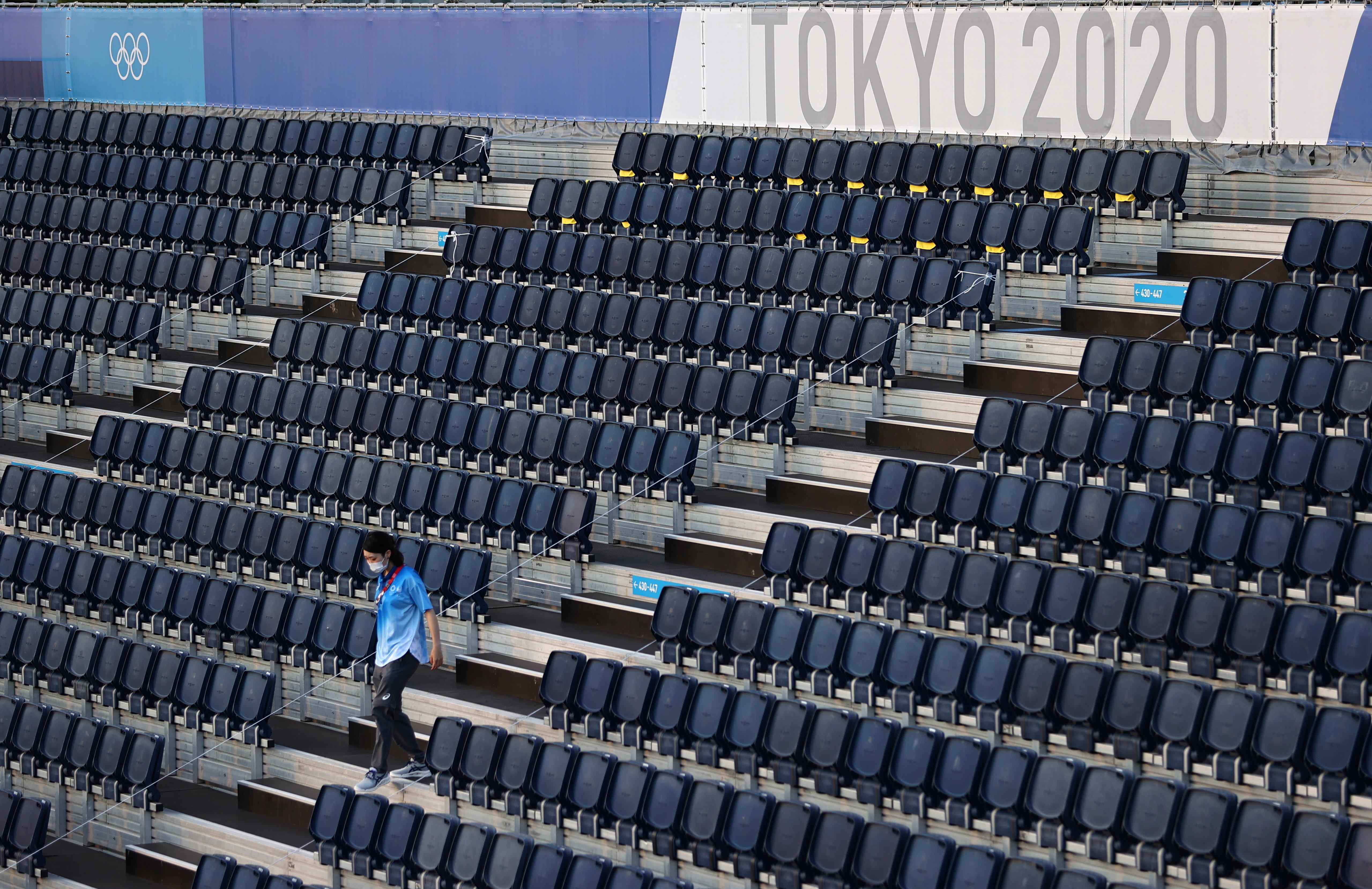 Tokyo 2020 Olympics - Beach Volleyball Training - Shiokaze Park, Tokyo, Japan - July 19, 2021 A volunteer walks in a stand REUTERS/Edgar Su - UP1EH7J0S9N29