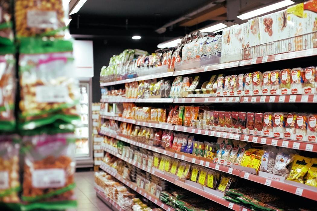 A supermarket shows food on a shelf.