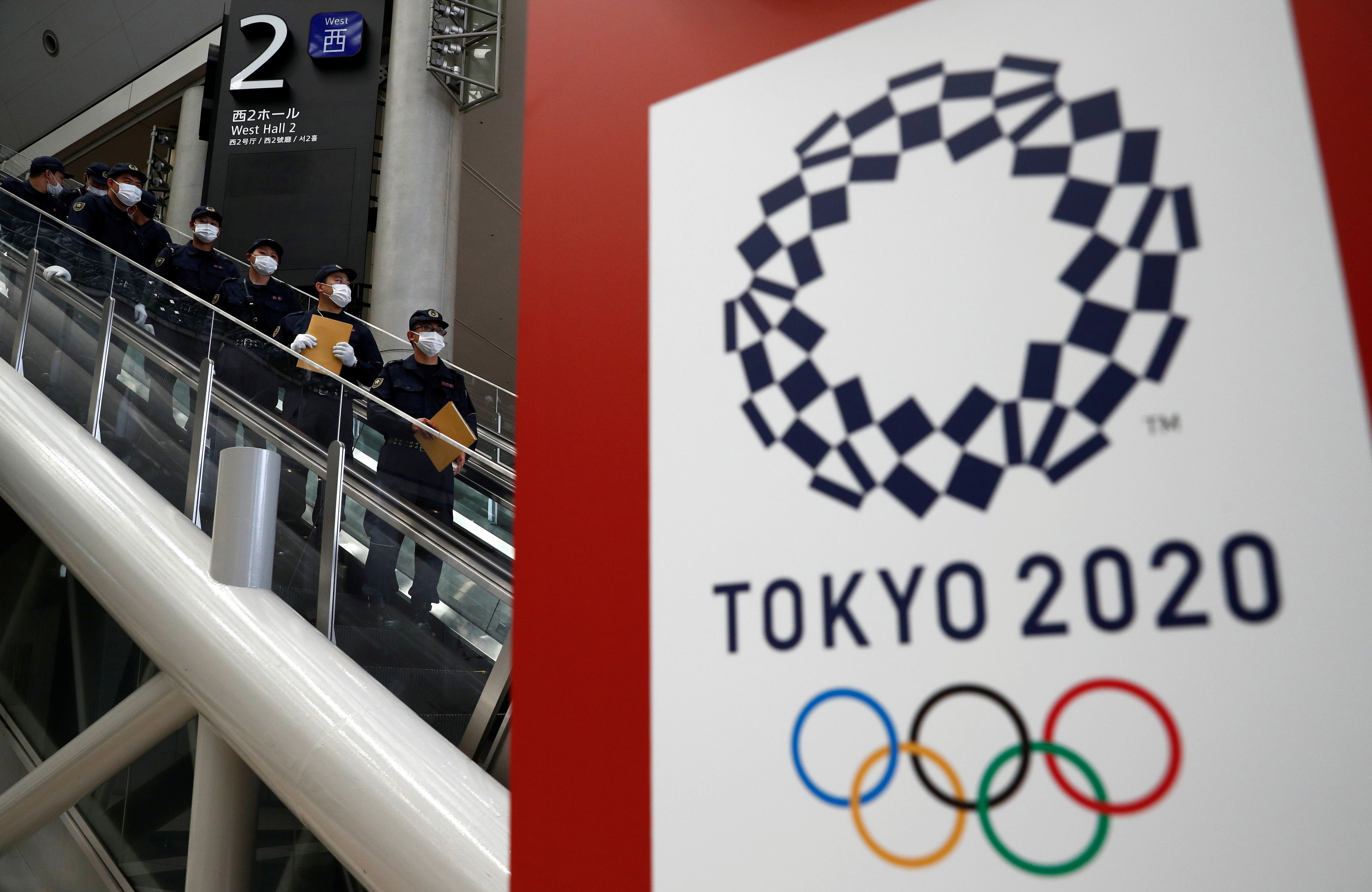Police officers conduct a security sweep of the Tokyo Olympic Main Press Center in Tokyo, Japan July 12, 2021.   REUTERS/Edgar Su - RC2QIO9X1CA1