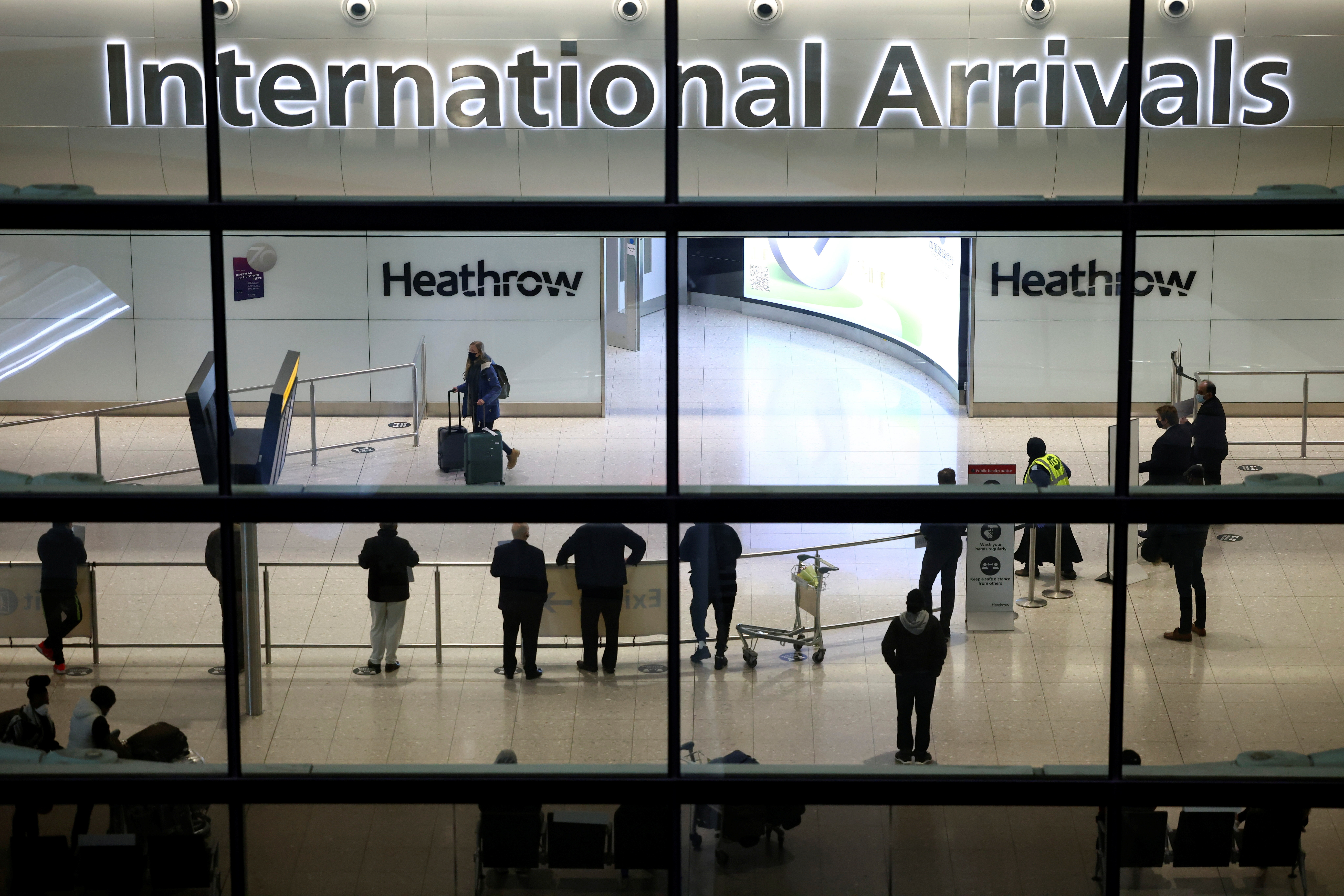 People wait at the arrivals area, as tighter rules for international travellers start, at terminal 2 of the Heathrow Airport, amid the spread of the coronavirus disease (COVID-19) pandemic, London, Britain, January 18, 2021. REUTERS/Henry Nicholls - RC2AAL97O1CF