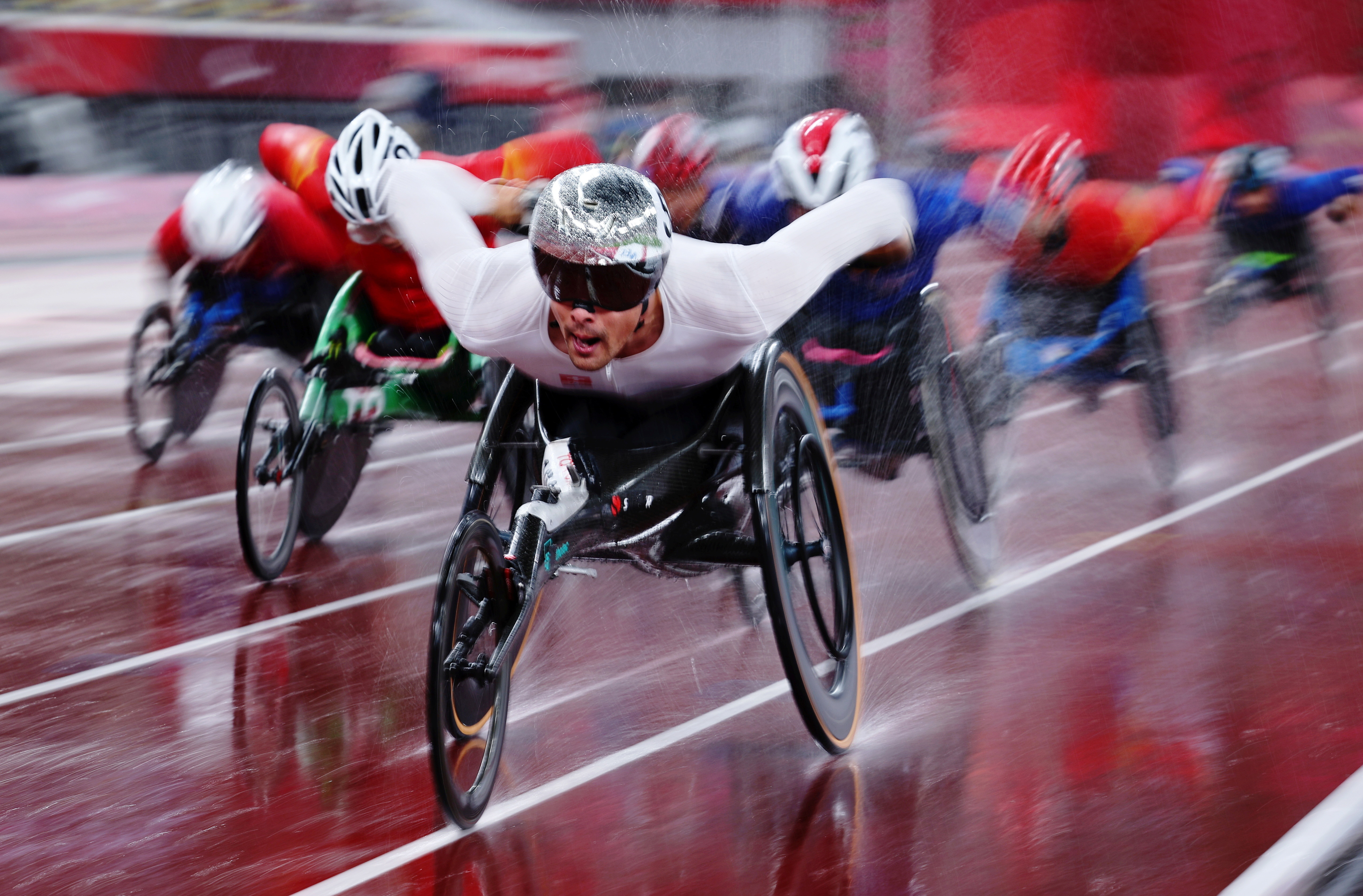 athletes compete at the Tokyo 2020 Paralympic Games in wheelchairs