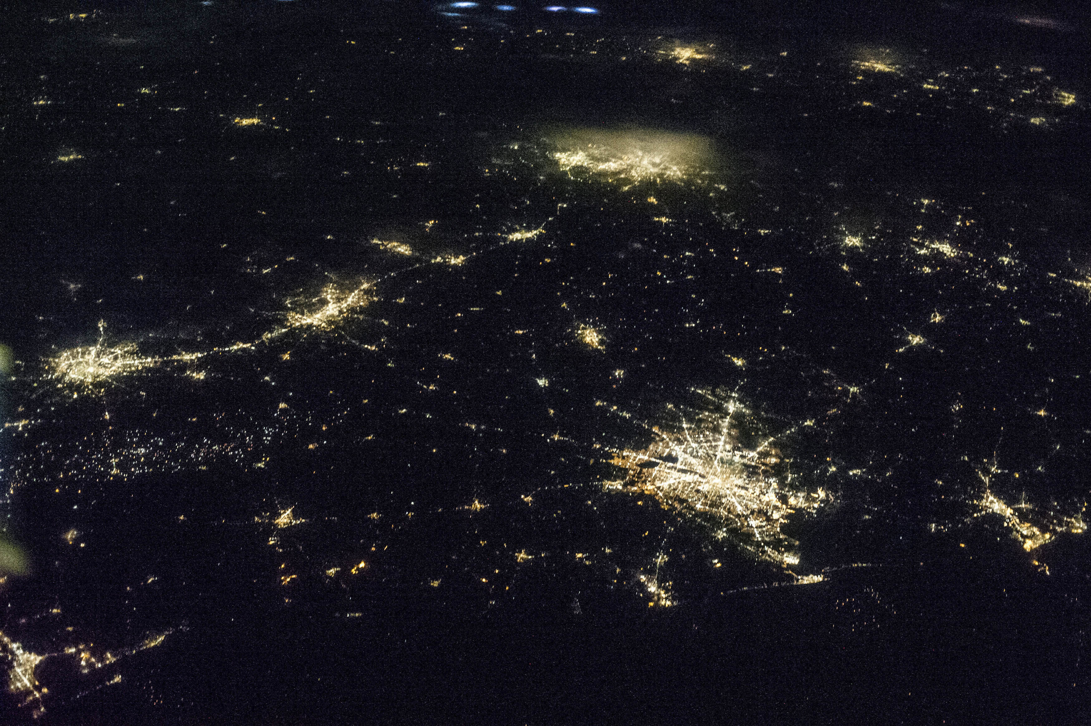 The state of Texas is captured by one of the NASA Expedition 36 crew members aboard the International Space Station, some 240 miles above Earth, used a 50mm lens in this image released on June 27, 2013. The largest metro area, Dallas-Fort Worth, often referred to informally as the Metroplex, is the heavily cloud-covered area at the top center of the photo. Neighboring Oklahoma, on the north side of the Red River, less than 100 miles to the north of the Metroplex, appears to be experiencing thunderstorms. The Houston metropolitan area, including the coastal city of Galveston, is at lower right. To the east near the Texas border with Louisiana, the metropolitan area of Beaumont-Port Arthur appears as a smaller blotch of light, also hugging the coast of the Texas Gulf. Moving inland to the left side of the picture one can delineate the San Antonio metro area. The capital city of Austin can be seen to the northeast of San Antonio.  REUTERS/NASA/Handout via Reuters  (UNITED STATES - Tags: ENERGY SCIENCE TECHNOLOGY CITYSCAPE) ATTENTION EDITORS - FOR EDITORIAL USE ONLY. NOT FOR SALE FOR MARKETING OR ADVERTISING CAMPAIGNS. THIS IMAGE HAS BEEN SUPPLIED BY A THIRD PARTY. IT IS DISTRIBUTED, EXACTLY AS RECEIVED BY REUTERS, AS A SERVICE TO CLIENTS - GM1E96S01BI02